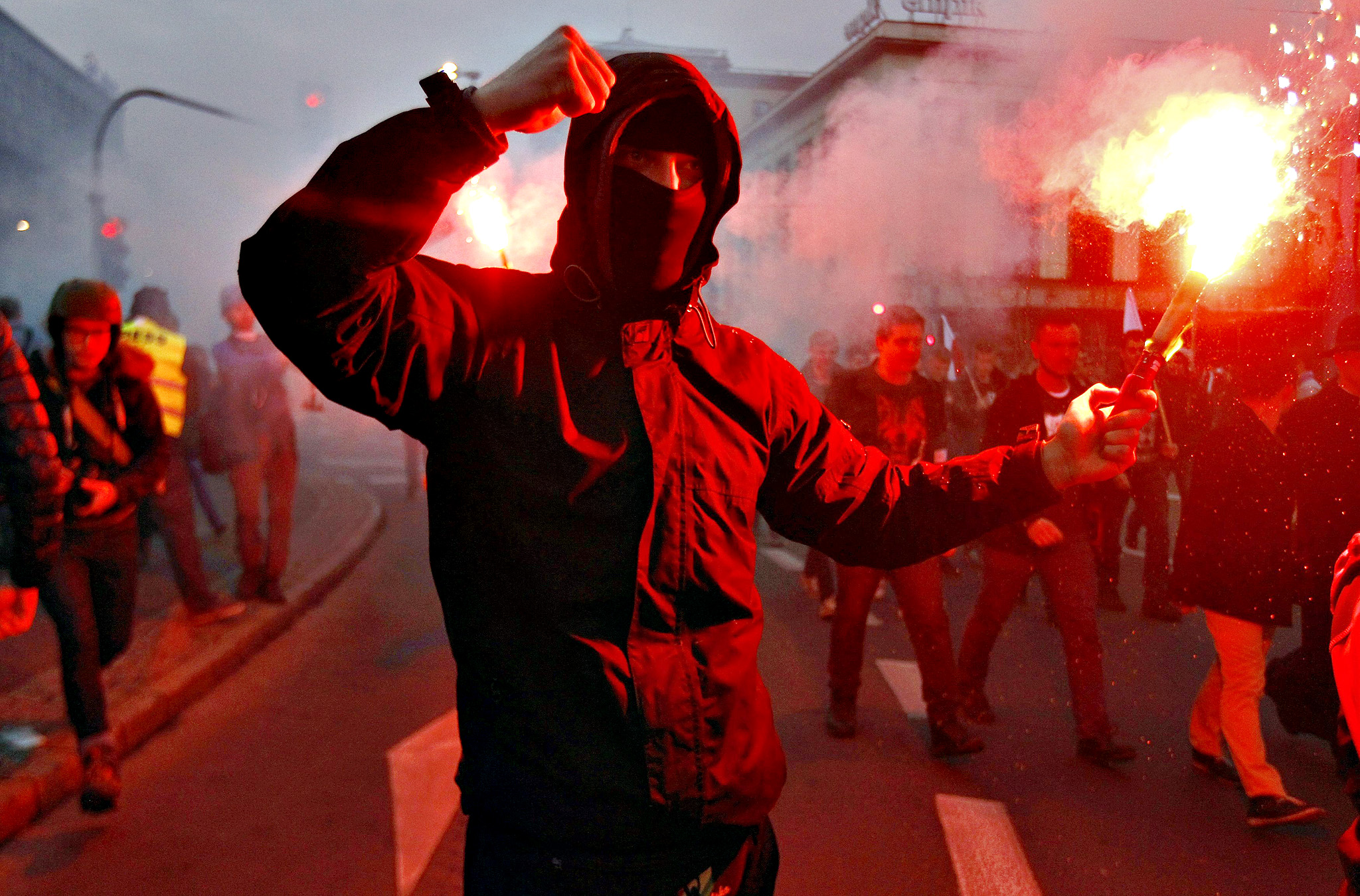 A far-right protester holds a flare during the annual far-right rally, which coincides with Poland's National Independence Day in Warsaw November 11, 2014.