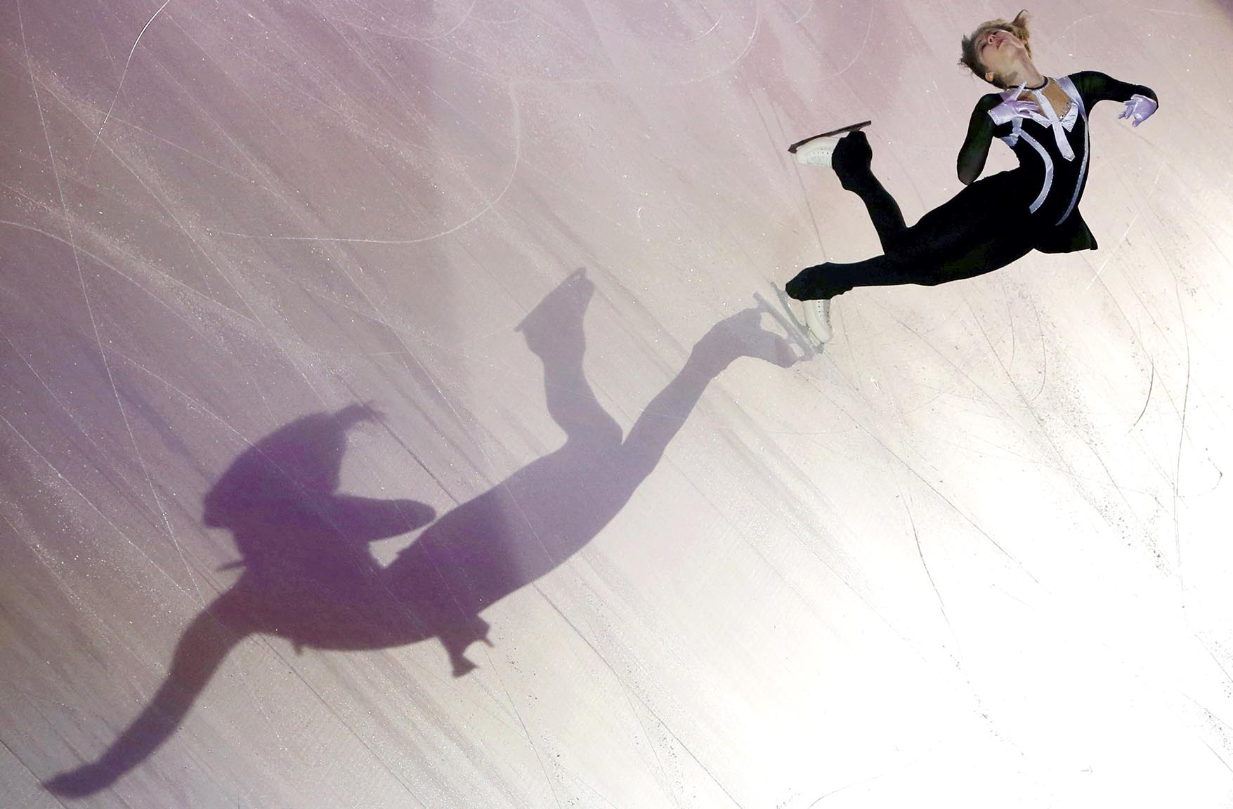 A shadow is cast on the ice as Julia Lipnitskaia of Russia performs during the gala exhibition at the ISU Bompard Trophy Figure Skating event in Bordeaux