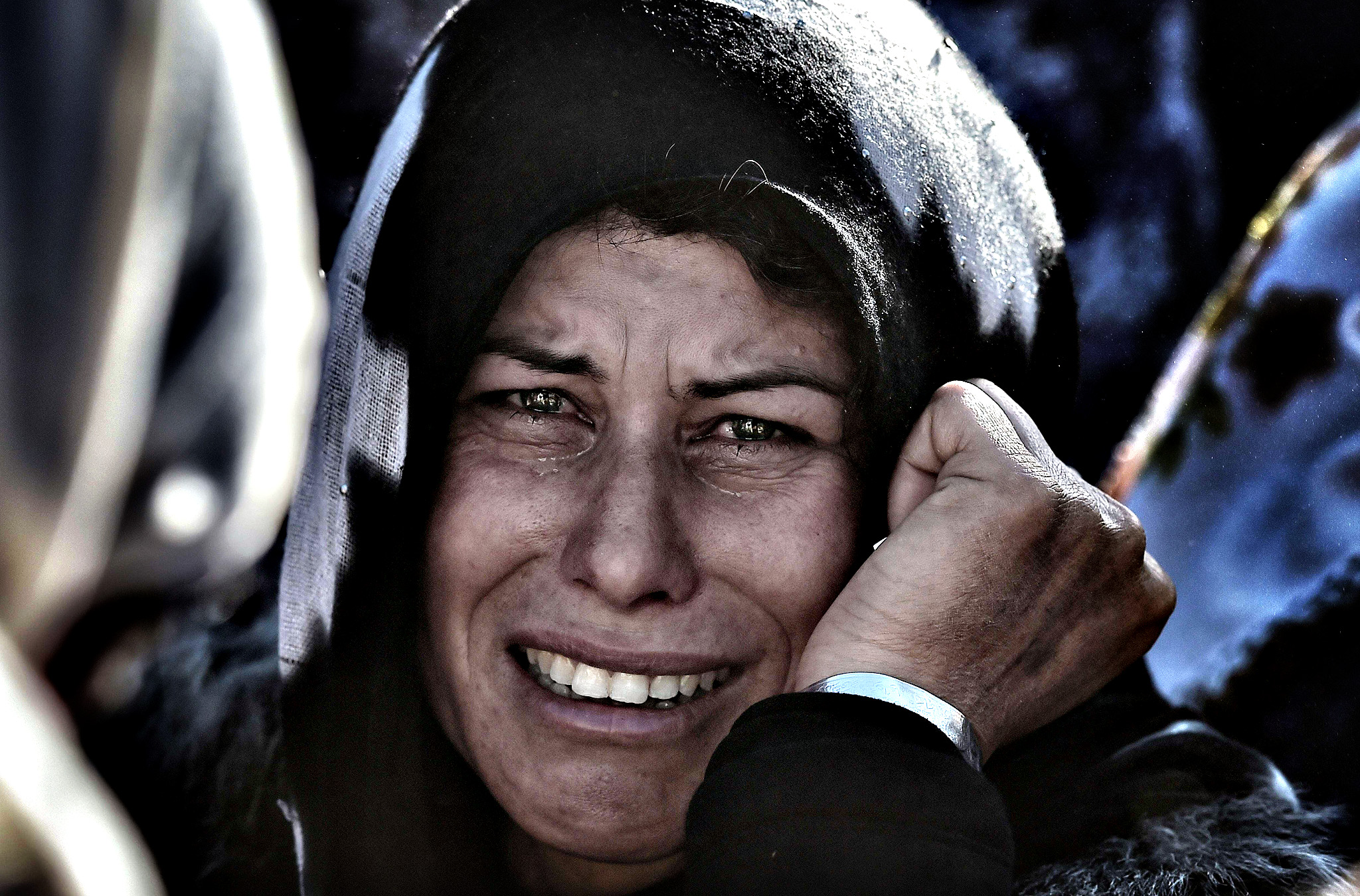 A woman cries during the funeral of a Kurdish People's Protection Units (YPG) fighter in Suruc, Turkish southeastern Sanliurfa province, on November 6, 2014. Turkey is pursuing a delicate but dangerous strategy after allowing peshmerga fighters to transit its soil to the besieged Syrian town of Kobane, fearing Kurdish domination of northern Syria but also risking the collapse of the peace process with Turkish Kurds.