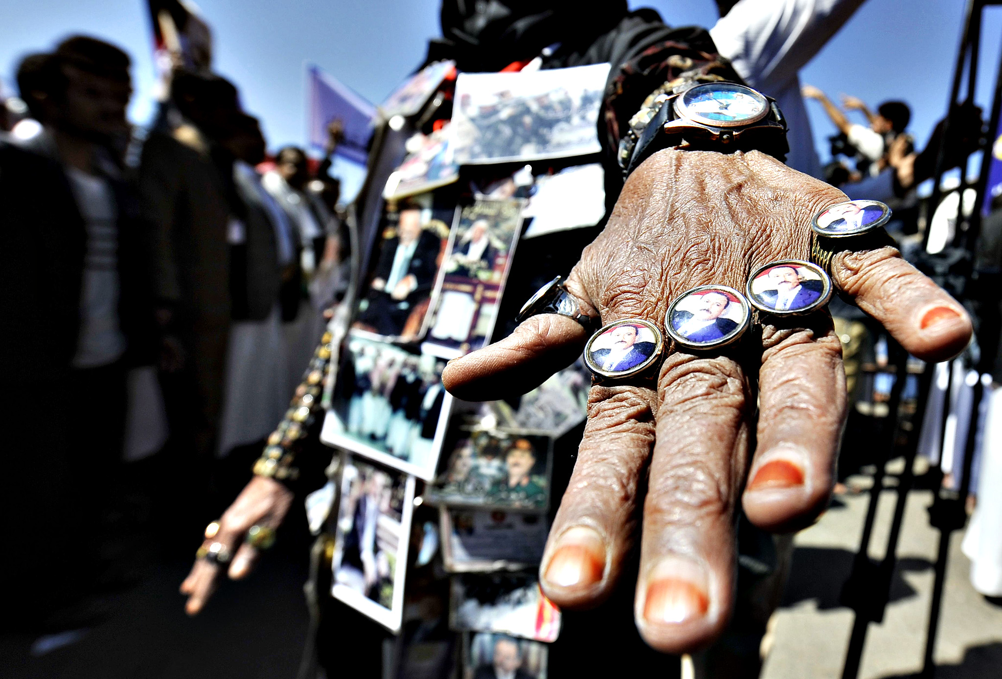 A Yemeni woman wears buttons depicting Yemen's ex-president Ali Abdullah Saleh during a gathering to protest against foreign interferences, in Sana'a, Yemen, 07 November 2014. Reports state thousands of supporters of former Yemeni president Ali Abdullah Saleh gathered in center Sana'a to protest against a US-backed move of the UN Security Council to impose a travel ban and assets freeze on Saleh due to his involvement in obstructing the country s transitional process. Recently, he has been accused of colluding with Shiite Houthi fighters in their military takeover of much of Yemen.