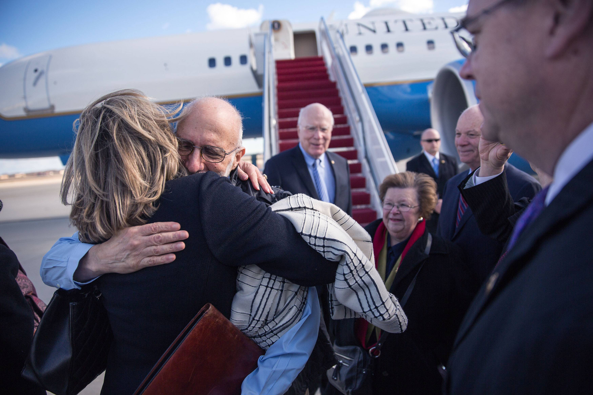 Alan Gross is greeted with hugs after arriving at Joint Base Andrews, Maryland in this White House handout photo...Alan Gross is greeted with hugs after arriving at Joint Base Andrews, Maryland in this December 17, 2014 White House handout photo. The United States and Cuba agreed on Wednesday to restore diplomatic ties that Washington severed more than 50 years ago, and President Barack Obama called for an end to the long economic embargo against its old Cold War enemy.  Gross spent 5 years as a prisoner in Cuba. REUTERS/Lawrence Jackson/White House/Handout via Reuters  (UNITED STATES - Tags: POLITICS) THIS IMAGE HAS BEEN SUPPLIED BY A THIRD PARTY. IT IS DISTRIBUTED, EXACTLY AS RECEIVED BY REUTERS, AS A SERVICE TO CLIENTS. FOR EDITORIAL USE ONLY. NOT FOR SALE FOR MARKETING OR ADVERTISING CAMPAIGNS