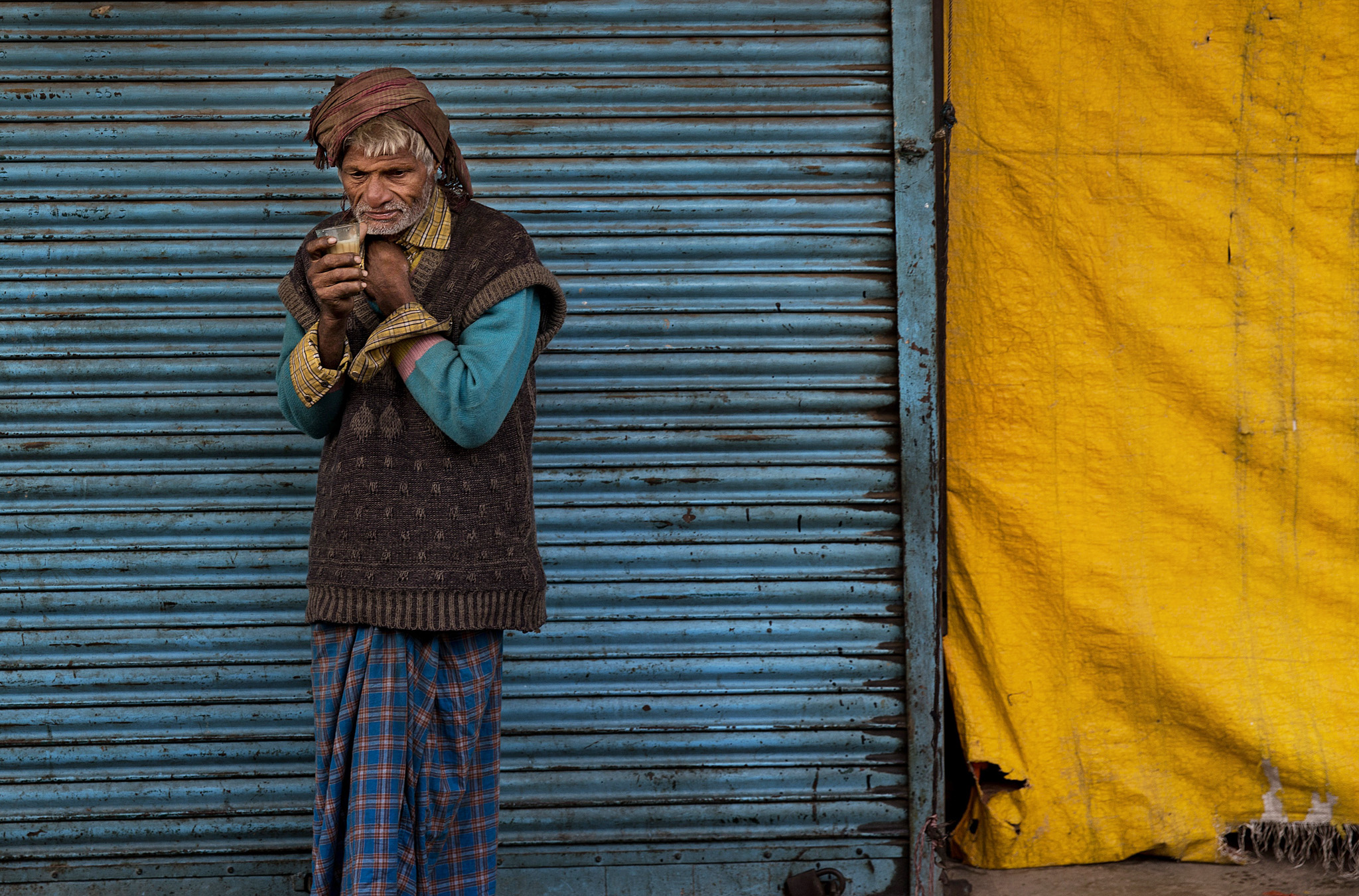 An Indian elderly man drinks tea to beat the cold early morning in old parts of New Delhi, India, Monday, Dec. 15, 2014. Cold wave conditions have intensified in the capital after scattered rains occurred in some parts of the city on Sunday, according to local reports. (AP Photo/Bernat Armangue)
