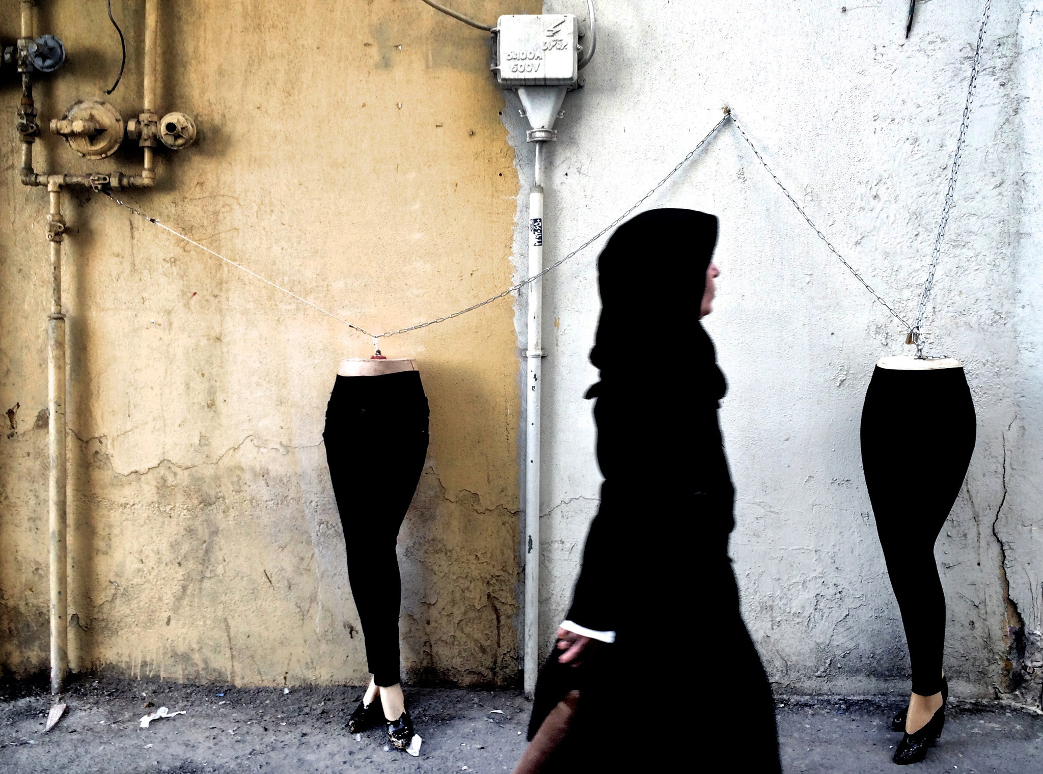 An Iranian woman walks past mannequins l...An Iranian woman walks past mannequins locked to a gas pipe in northern Tehran on December 15, 2014. AFP PHOTO/BEHROUZ MEHRIBEHROUZ MEHRI/AFP/Getty Images