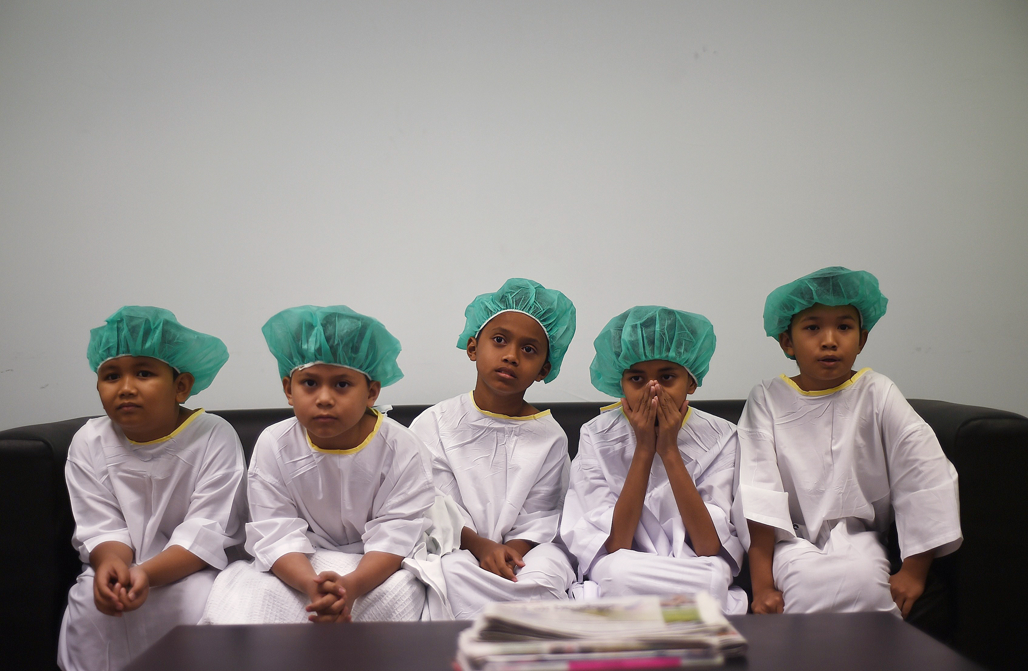 TOPSHOTS Malaysian boys wait for their t...TOPSHOTS Malaysian boys wait for their turn during a mass-circumcision ceremony at the Tuanku Mizan Army hospital in Kuala Lumpur on December 5, 2014. 112 children participated in the event organised by the Ministry of Defence for children of defence personnel, with a grand welcome and festivity, which some consider as a celebration of reaching manhood.   AFP PHOTO / MANAN VATSYAYANAMANAN VATSYAYANA/AFP/Getty Images