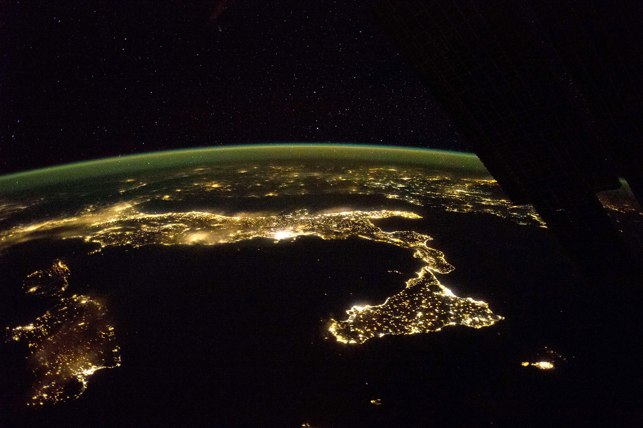 "This image released by NASA December 15,...This image released by NASA December 15, 2014 shows the easily recognized boot of Italy, with Sicily at its toe, spread across this panorama taken October 21 by astronauts aboard the International Space Station(ISS). On a clear night looking east, the pattern of night lights shows populations concentrated mainly along the coastlines, but also in the Po River Valley of northern Italy(L). Some of the brightest clusters of lights are Rome and nearby Naples, with island cities of Cagliari on Sardinia and Catania on Sicilynow well-known as the hometown of European Space Agency astronaut Luca Parmitano. The small, dark, circular patch dangerously close to Catania marks the unpopulated slopes of the active volcano Etna. Hazy lights, as over the Po valley and Rome, probably indicate thin clouds above. The island of Malta appears at the lower right. The airglow line is vivid in this night shot. AFP PHOTO / HANDOUT / NASA   == RESTRICTED TO EDITORIAL USE / MANDATORY CREDIT: ""AFP PHOTO / HANDOUT / NASA  ""/ NO MARKETING / NO ADVERTISING CAMPAIGNS / NO A LA CARTE SALES / DISTRIBUTED AS A SERVICE TO CLIENTS ==Handout/AFP/Getty Images"