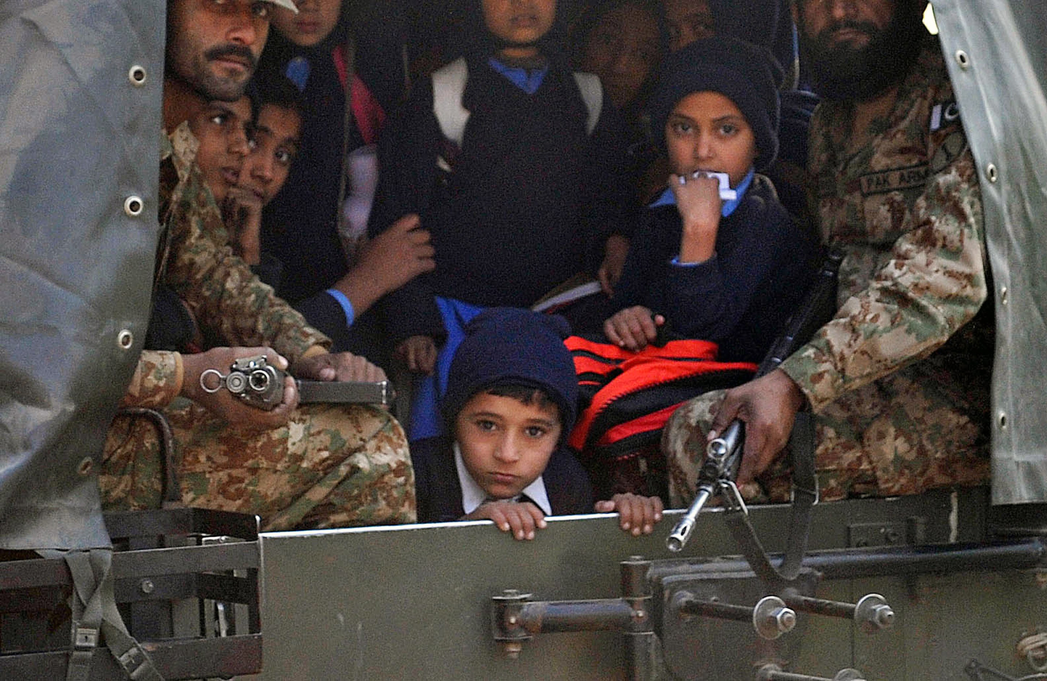 Pakistani soldiers transport rescued school children from the site of an attack by Taliban gunmen on a school in Peshawar on December 16, 2014. Taliban insurgents killed at least 130 people, most of them children, after storming an army-run school in Pakistan December 16 in one of the country's bloodiest attacks in recent years.