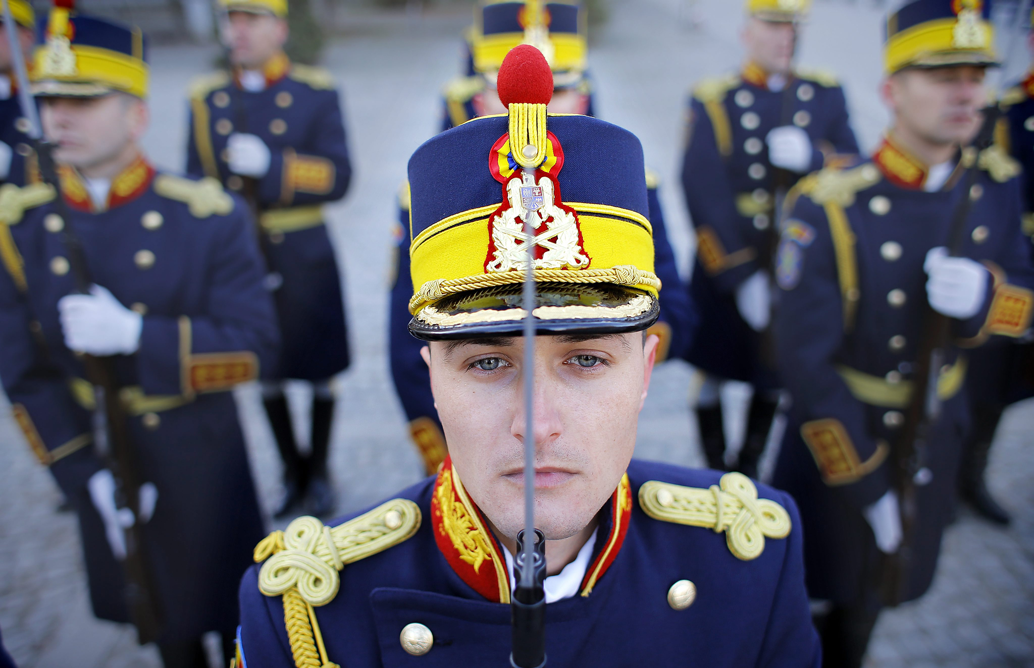 Romanians Commemorate 25th Anniversary of 1989 Revolution...epa04538040 Romanian Honor Guard soldiers pay respects to the victims of the 1989 revolution during a commemoration ceremony held at Heroes of the Revolution Memorial, in central Bucharest, Romania, 22 December 2014. Romanians these days pay their respect to the 1989 activists who took to the streets 25 years ago, taking part at the revolution that toppled Eastern Europe's most repressive communist regime. More than 1,000 people were killed across Romania during clashes between demonstrators and  forces loyal to then dictator Nicolae Ceausescu.  EPA/ROBERT GHEMENT