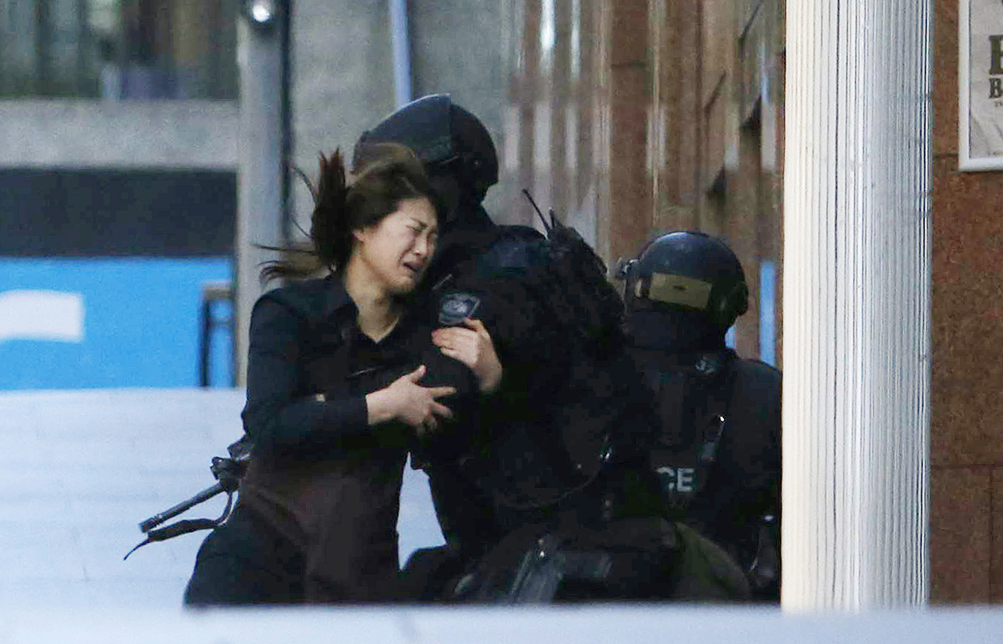 "REUTERS PICTURE HIGHLIGHT...ATTENTION EDITORS - REUTERS PICTURE HIGHLIGHT TRANSMITTED BY 0730 GMT ON DECEMBER 15, 2014    TBW26 - A hostage runs towards a police officer outside Lindt cafe, where other hostages are being held, in Martin Place in central Sydney December 15, 2014. REUTERS/Jason Reed     REUTERS NEWS PICTURES HAS NOW MADE IT EASIER TO FIND THE BEST PHOTOS FROM THE MOST IMPORTANT STORIES AND TOP STANDALONES EACH DAY. Search for ""TPX"" in the IPTC Supplemental Category field or ""IMAGES OF THE DAY"" in the Caption field and you will find a selection of 80-100 of our daily Top Pictures.    REUTERS NEWS PICTURES.     TEMPLATE OUT"