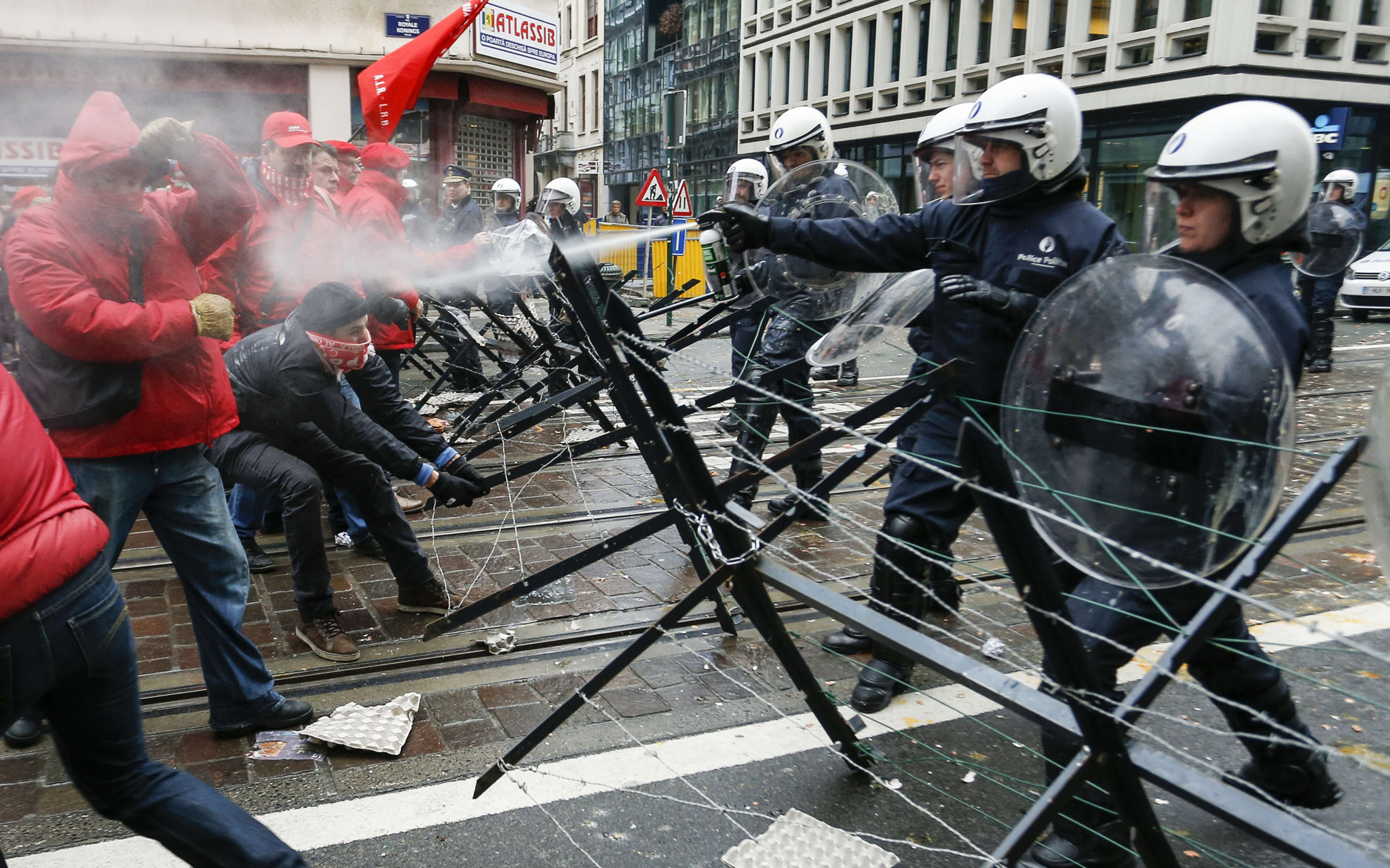Union members clash with police in Brussels during a national general strike which was called for by the different unions to protest against austerity measures.