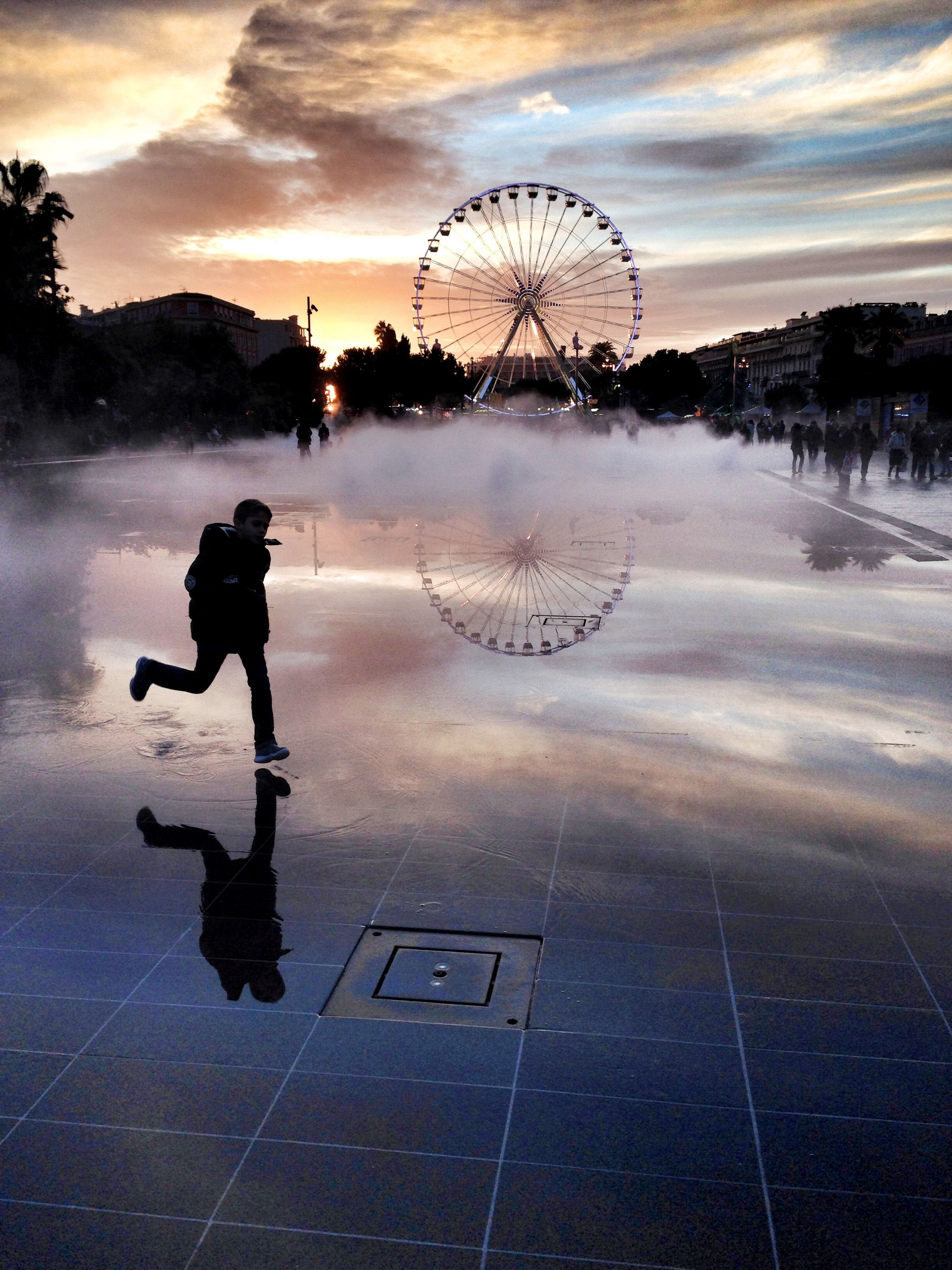 A child runs in front of Ferris wheel on...A child runs in front of Ferris wheel on December 16, 2014 in downtown Nice, southeastern France. AFP PHOTO / VALERY HACHEVALERY HACHE/AFP/Getty Images