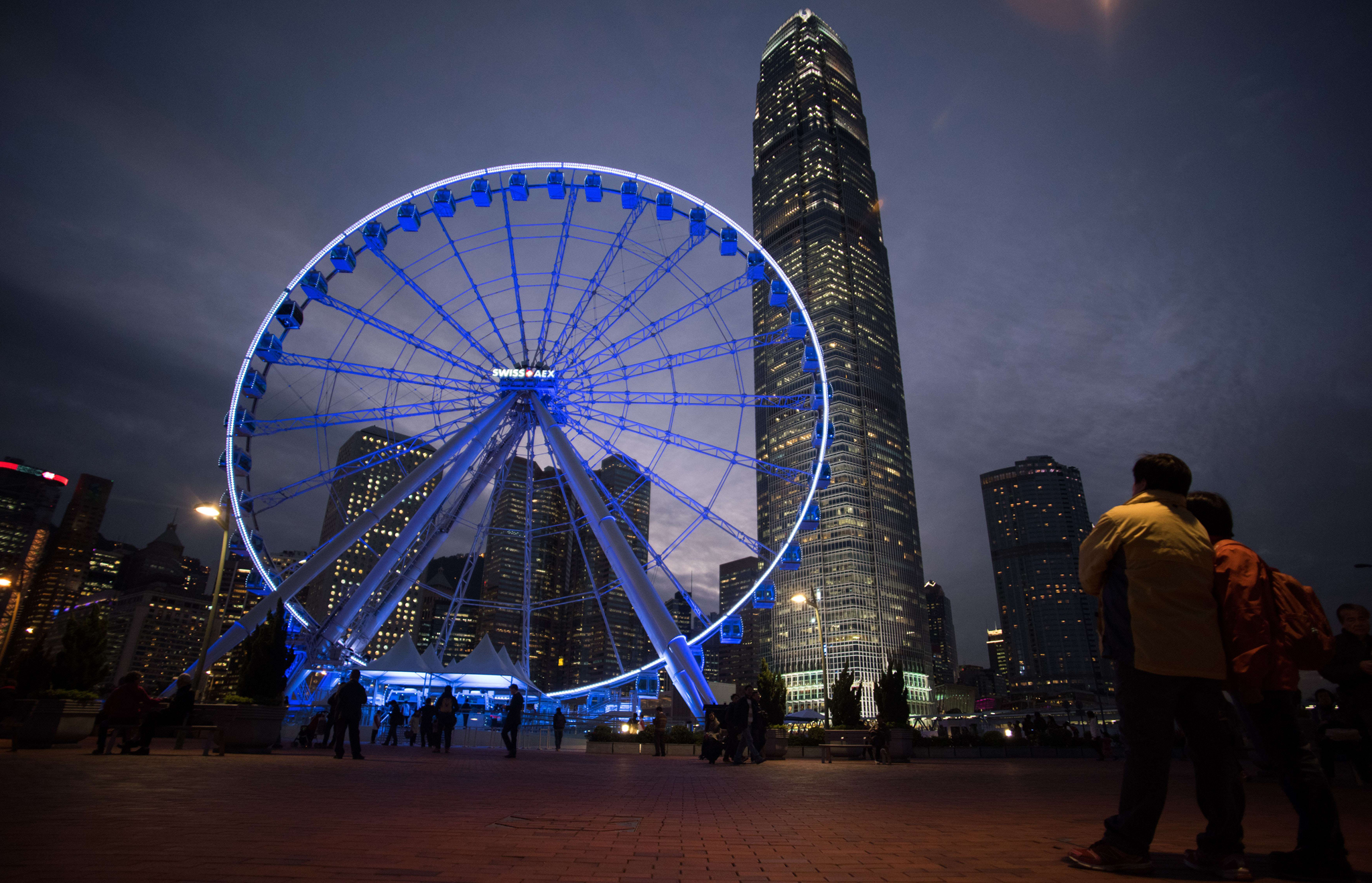 A giant 60-meter-tall ferris wheel is lit up as it is used by passengers for the first time, in the Admiralty district of Hong Kong