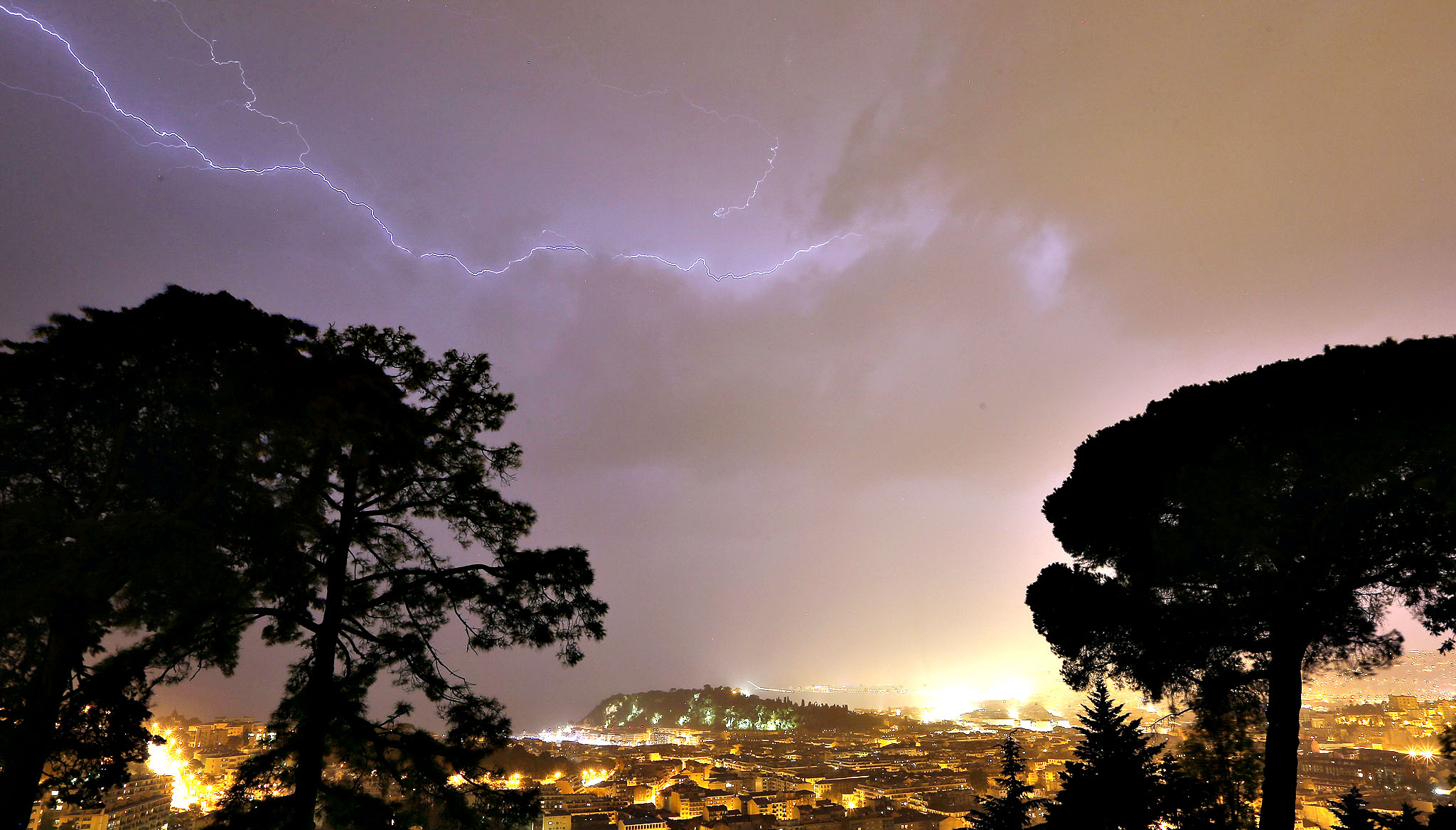 "A flash of lighting lights up the sky above the ""Baie des Anges"" in Nice, southeastern France."