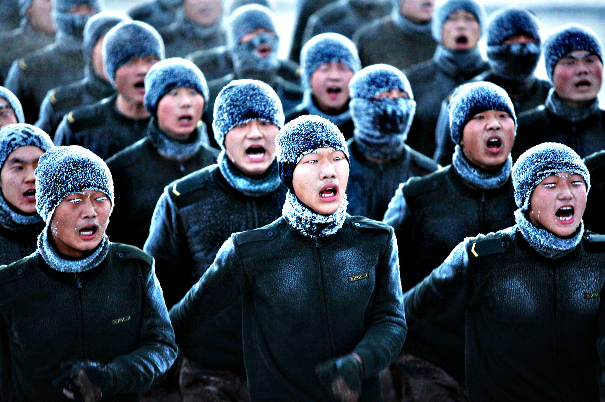 Soldiers shout as they practise in temperatures of about minus 30 degrees centigrade (-22 F) in Heihe, Heilongjiang province
