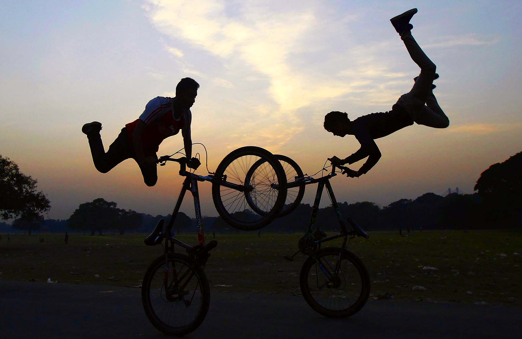 Cyclists perform a stunt as they practice ahead of the Hip-Hop Carnival in Kolkata