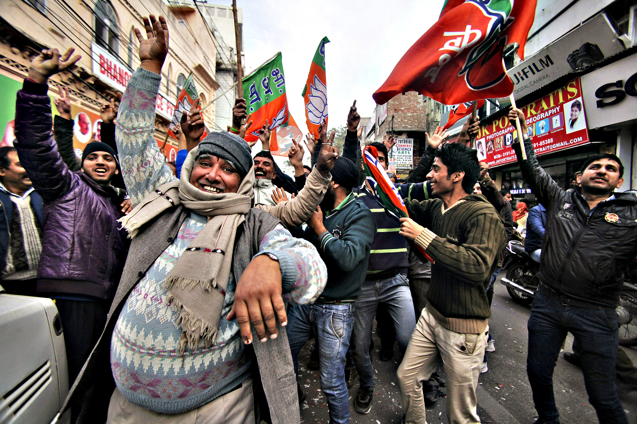 Bharatiya Janata Party (BJP) supporters dance to celebrate the news of early election result trends outside their party headquarters in Jammu, India, Tuesday, Dec. 23, 2014. India's ruling Hindu nationalist Bharatiya Janta Party is poised to emerge as an important political player in the disputed Himalayan region of Kashmir, as votes in local elections are being counted.