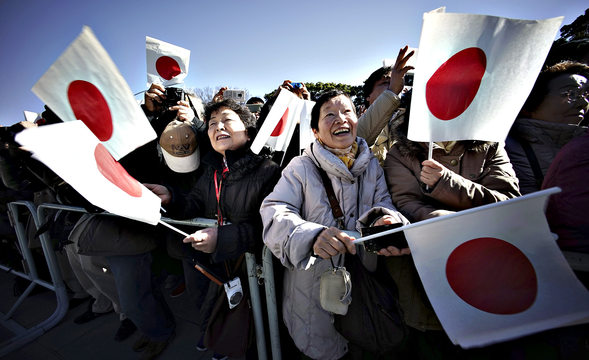 Well-wishers wave Japanese flags to celebrate Japan's Emperor Akihito's 81st birthday at the Imperial Palace in Tokyo, Tuesday, Dec. 23, 2014. Emperor Akihito said he  ardently  hoped Japan will strive hard as a peaceful country, as he celebrated his 81th birthday Tuesday ahead of the 70th anniversary of the end of World War II next year.