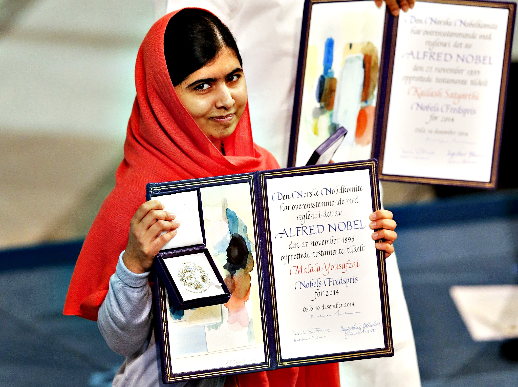 Nobel Peace Prize laureate Malala Yousafzai poses with the medal and the diploma during the Nobel Peace Prize awards ceremony at the City Hall in Oslo December 10, 2014. Pakistani teenager Yousafzai, shot by the Taliban for refusing to quit school, and Indian activist Kailash Satyarthi received their Nobel Peace Prizes on Wednesday after two days of celebration honouring their work for children's rights.
