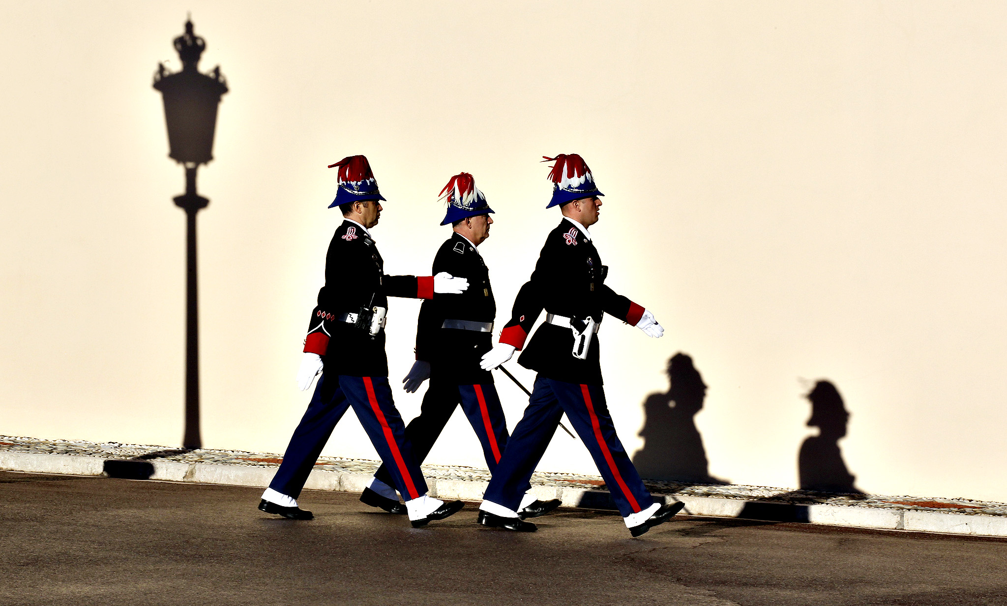 Monaco guards arrive for a ceremony announcing the birth of Monaco royal twins Gabriella Therese Marie and Jacques Honore Rainier, outside the Palace in Monaco, Thursday, Dec.11 , 2014.  For the first time since Monaco was founded in the 13th century, its royal family gave birth to twins on Wednesday, and dozens of cannons were fired to celebrate. Monaco's Princess Charlene had a girl first and a boy second, but the boy will be the principality's future ruler, reflecting the male priority of Monaco's laws of succession.