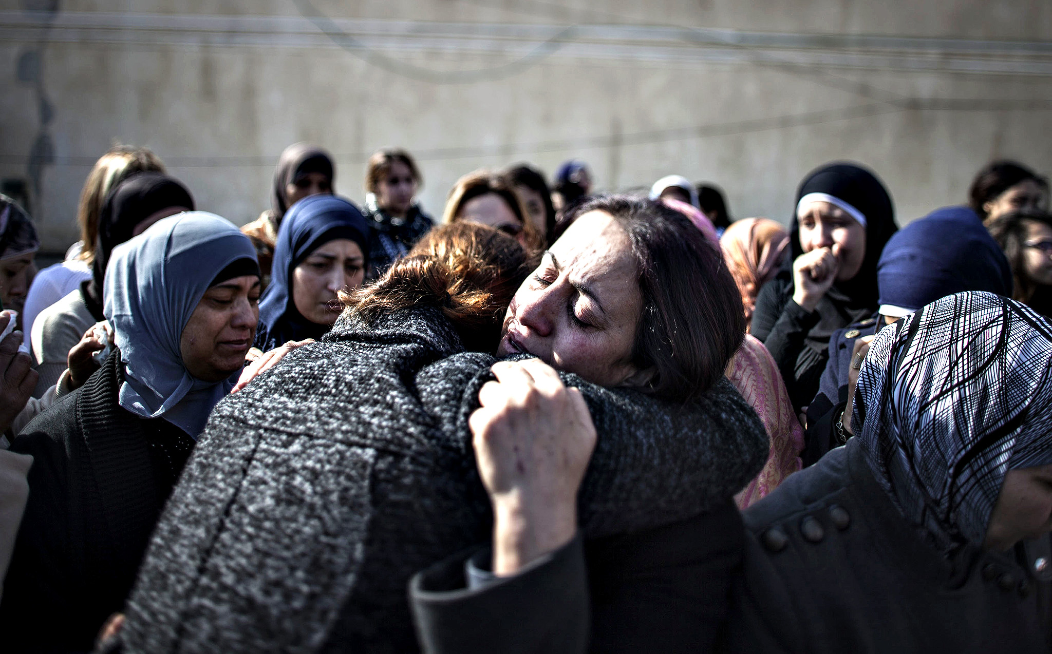 Family members mourn and cry during a funeral of Minister Ziad Abu Ein on Thursday in Ramallah, West Bank. The Palestinian Minister died yesterday from a suspected heart attack after confronting Israeli security forces in West Bank demonstration.