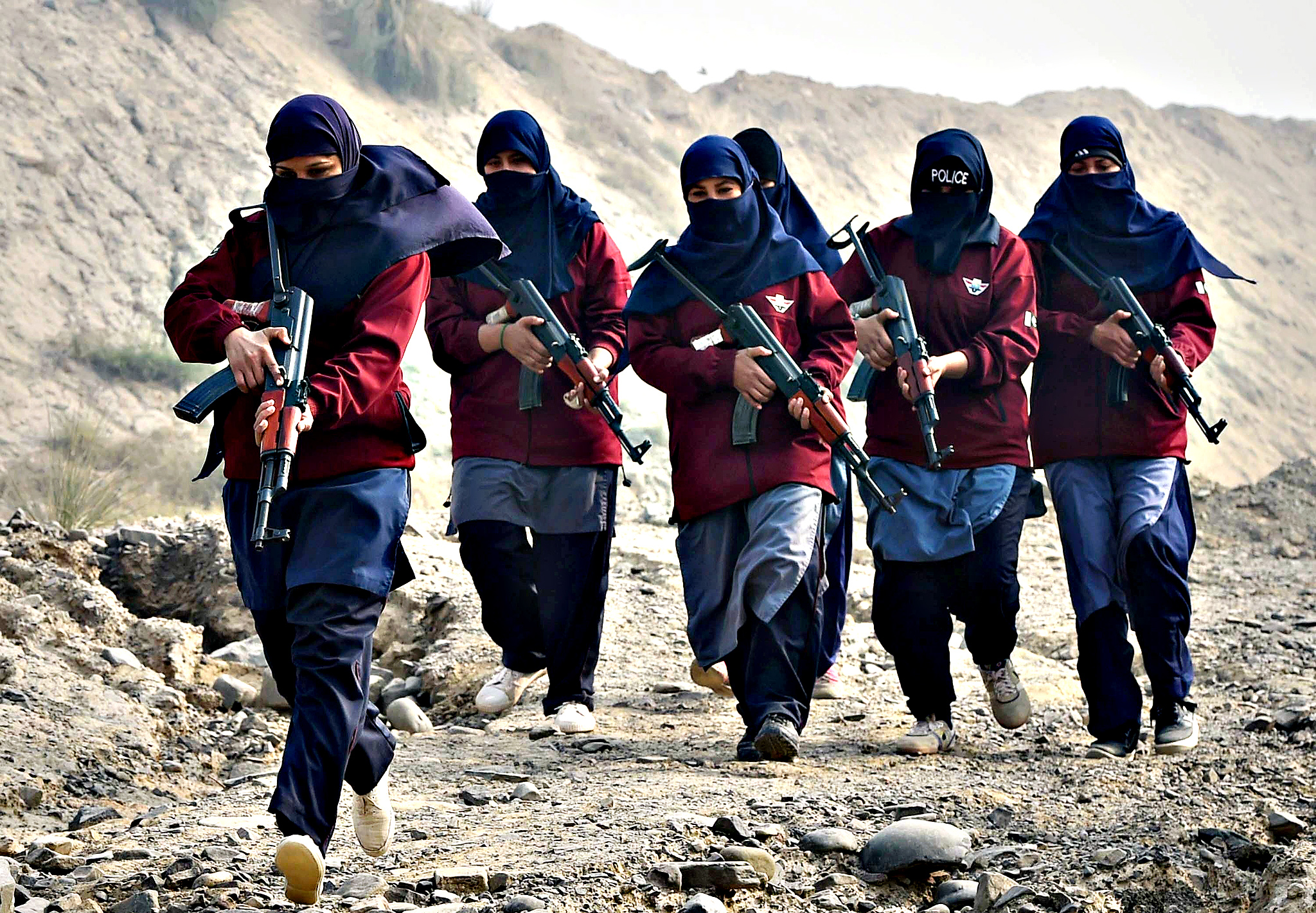 "Female Pakistani police commandos during an exercise at a police training centre in Nowshera, a district in the Khyber Pakhtunkhwa Province. The army has been waging a major offensive against longstanding Taliban and other militant strongholds in the restive tribal areas on the Afghan border for the last six months. But a series of fresh strikes after the December 16 Peshawar attack, which left 149 people dead -- most of them children, suggest the military is stepping up its campaign. As the Peshawar tragedy unfolded, army chief General Raheel Sharif said the attack had renewed the forces' determination to push for the militants' ""final elimination""."