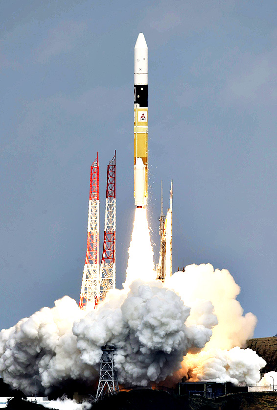 An H2-A rocket carrying space explorer Hayabusa2, lifts off from a launching pad at Tanegashima Space Center in Kagoshima, southern Japan, Wednesday, Dec. 3, 2014.  The Japanese space explorer was launched Wednesday on a six-year roundtrip journey to blow a crater in a remote asteroid and collect samples from inside in hopes of gathering clues to the origin of earth.