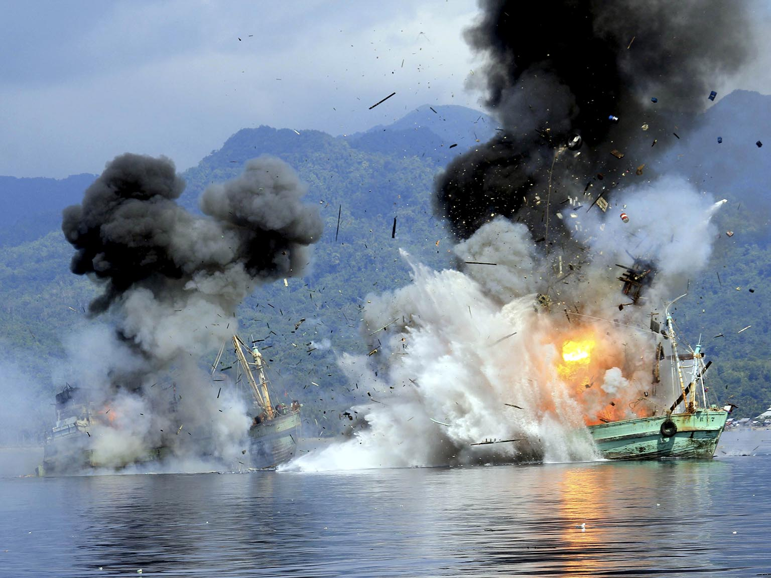 Foreign flagged fishing boats registered in Papua New Guinea are destroyed by the Indonesian Navy after they were seized earlier for supposedly illegal fishing off the coast of Ambon