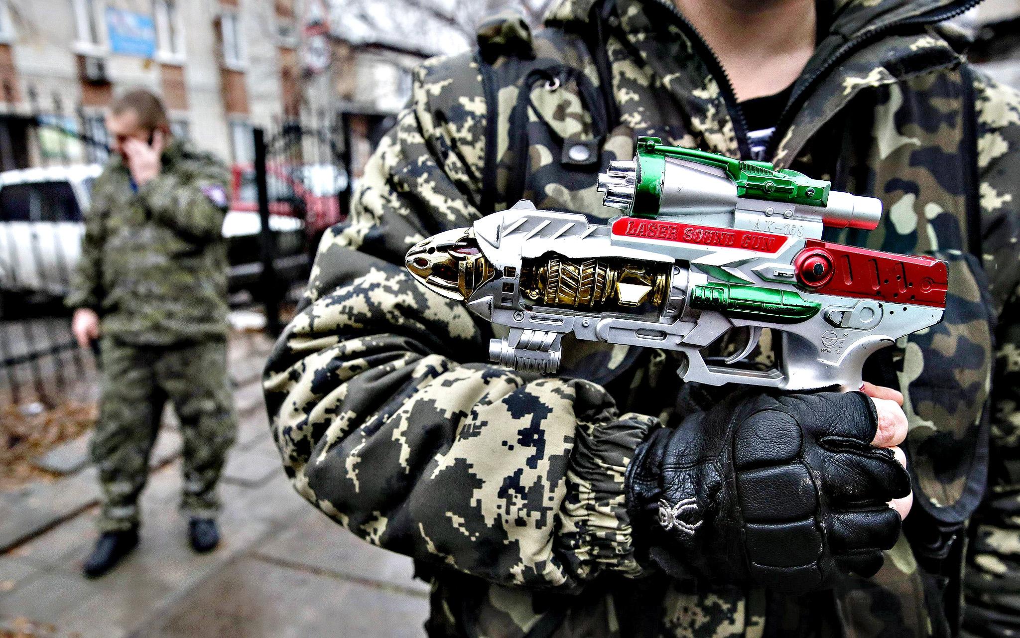 A pro-Russian rebel holds a toy gun in Donetsk December 18, 2014.