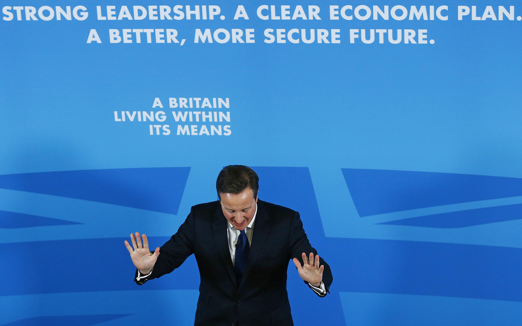 Britain's Prime Minister David Cameron gestures as he delivers a speech on the economy, in Nottingham, central England January 12, 2015.