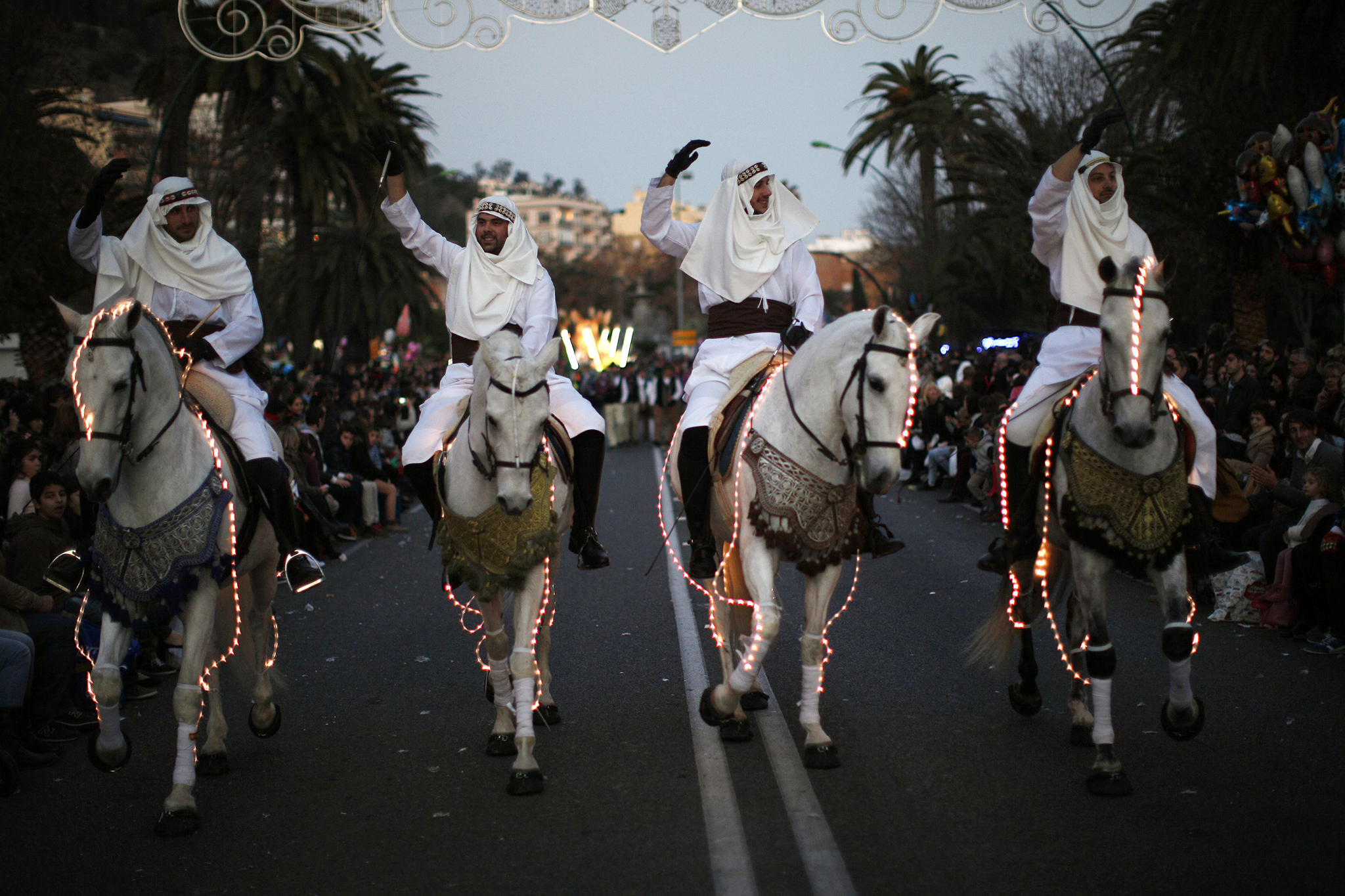 Horse riders wave to the crowd during the traditional Epiphany parade in Malaga...REFILE - CORRECTING YEAR  Horse riders wave to the crowd during the traditional Epiphany parade in Malaga, southern Spain January 5, 2015. Traditionally, children in Spain receive their presents delivered by the Three Wise Men on the morning of January 6 during the Christian holiday of the Epiphany. REUTERS/Jon Nazca (SPAIN - Tags: SOCIETY ANIMALS RELIGION)