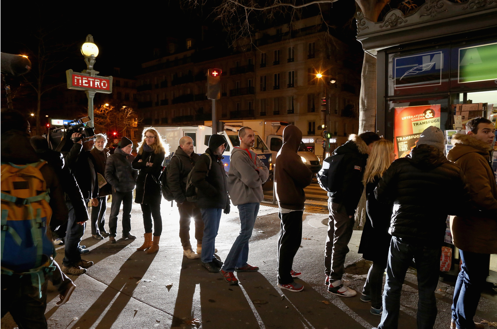 Parisians queue at a newspaper kiosk to get their copies of the latest edition of Charlie Hebdo magazine on January 14, 2015 in Paris, France. Three million copies of the controversial magazine have been printed  in the wake of last week's terrorist attacks.