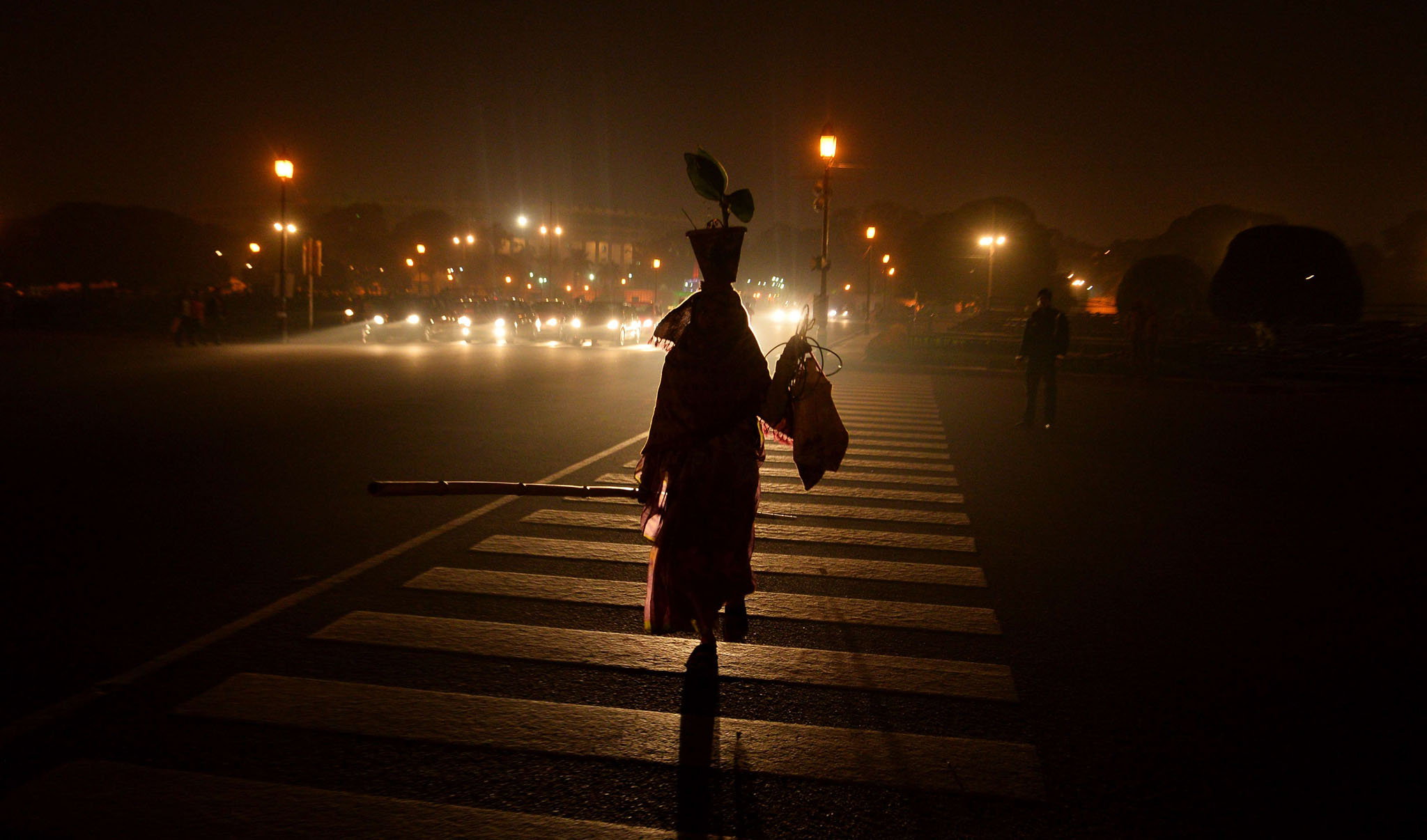 An Indian woman crosses the road in New ...An Indian woman crosses the road in New Delhi on January 20, 2015. India is part of a global trend that is advancing towards an increasing urbanisation, with more than half of the world's population living in towns and cities. AFP PHOTO / CHANDAN KHANNAChandan Khanna/AFP/Getty Images