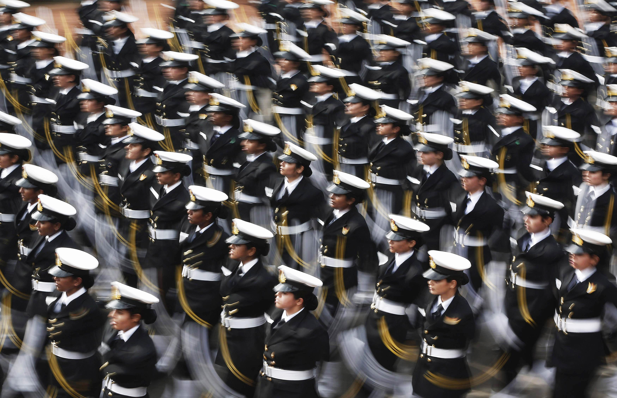 Indian soldiers march during the full dress rehearsal for the Republic Day parade in New Delhi January 23, 2015. India's capital will turn into a virtual fortress for U.S. President Barack Obama's visit this weekend, with heightened security measures, including an extended no-fly zone, to protect the world's most powerful leader. Indian Prime Minister Narendra Modi, Obama and other dignitaries from the world's two largest democracies will attend India's Republic Day celebrations on January 26, which include a military parade and display of Indian weaponry. REUTERS/Adnan Abidi (INDIA - Tags: MILITARY ANNIVERSARY POLITICS)
