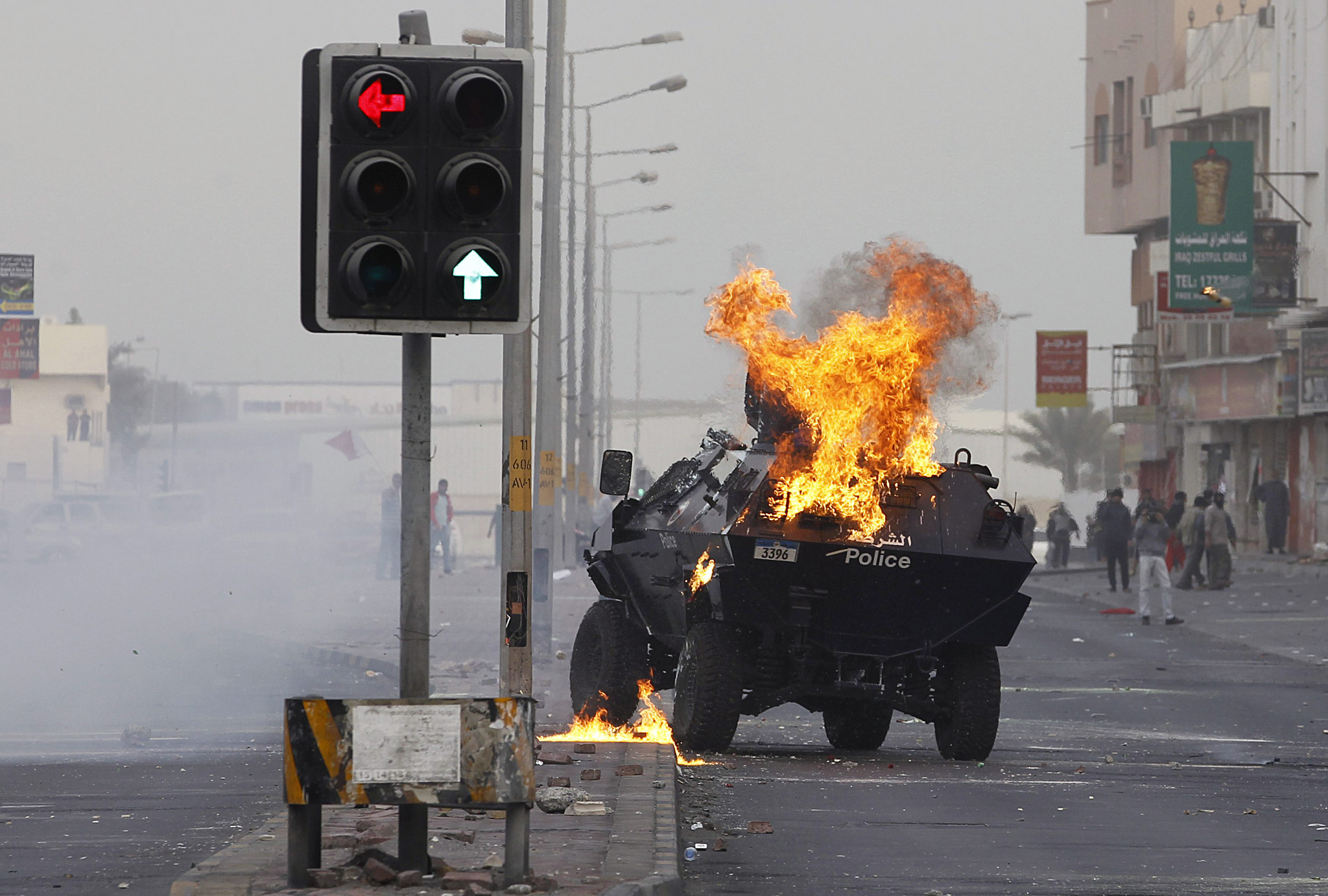 A Molotov cocktail which was thrown by protesters explodes on a riot police armoured personnel carrier at a highway in the village of Sitra, south of Manama, January 9, 2015. Several demonstrations calling for the release of Sheikh Ali Salman, head of the al-Wefaq Islamic Society, and resulting in clashes with riot police, were held across the country, local media reported. Ali Salman was arrested on December 28, 2014. Salman's lawyer Abdulla al-Shamlawi told Reuters he had been formally charged by the public prosecutor with inciting a change of government by force, inciting hatred of a segment of society, inciting others to break the law and publicly insulting the Interior Ministry. REUTERS/Hamad I Mohammed (BAHRAIN - Tags: POLITICS CRIME LAW)