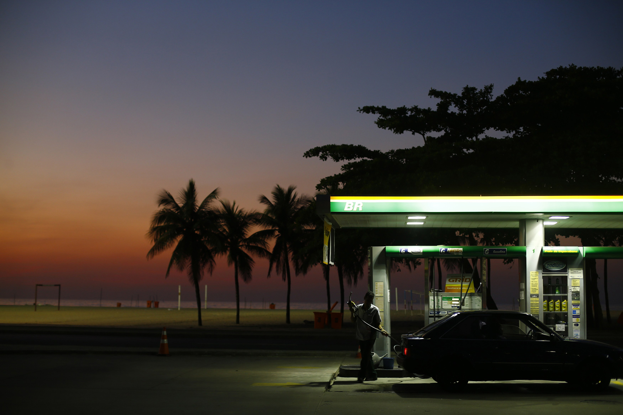 A worker prepares to fill a car at a gas station close to Copacabana beach in Rio de Janeiro...A worker prepares to fill a car at a gas station close to Copacabana beach in Rio de Janeiro, January 12, 2015. Reuters photographers from Mali to Mexico have shot a series of pictures of fuel stations. Whether it is plastic bottles by the roadside in Malaysia or a futuristic forecourt in Los Angeles, fuel stations help define our world. Oil prices steadied above $48 a barrel on Tuesday, recovering from earlier losses as the dollar weakened against the euro. Oil prices have dropped nearly 60 percent since peaking in June 2014 on ample global supplies from the U.S. shale oil boom and a decision by OPEC to keep its production quotas unchanged.   REUTERS/Ricardo Moraes (BRAZIL - Tags: TRANSPORT BUSINESS COMMODITIES ENERGY TPX IMAGES OF THE DAY)    ATTENTION EDITORS: PICTURE 01 OF 26 FOR WIDER IMAGE PACKAGE 'AT THE PUMP - THE WORLD FILLS UP'     SEARCH 'WORLD FILLS UP' FOR ALL IMAGES