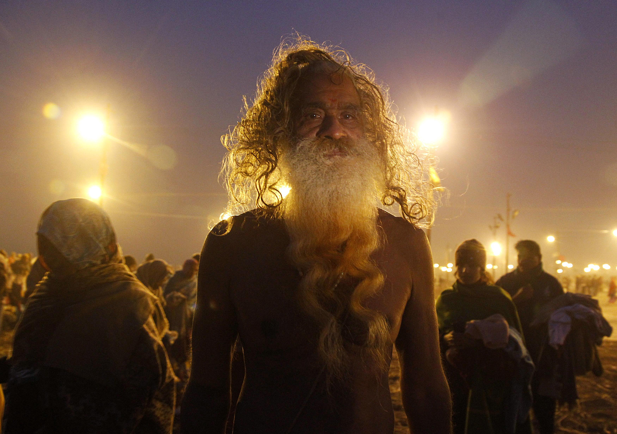 A Sadhu or a Hindu holyman arrives to take a holy dip at Sangam during Magh Mela in Allahabad...A Sadhu or a Hindu holyman arrives to take a holy dip at Sangam during Magh Mela in the northern Indian city of Allahabad January 5, 2015. The festival is an annual religious event held during the Hindu month of Magh, when thousands of devotees take a holy dip in the waters of Sangam, the confluence of the Ganges, Yamuna and Saraswati rivers. REUTERS/Jitendra Prakash (INDIA - Tags: RELIGION SOCIETY)