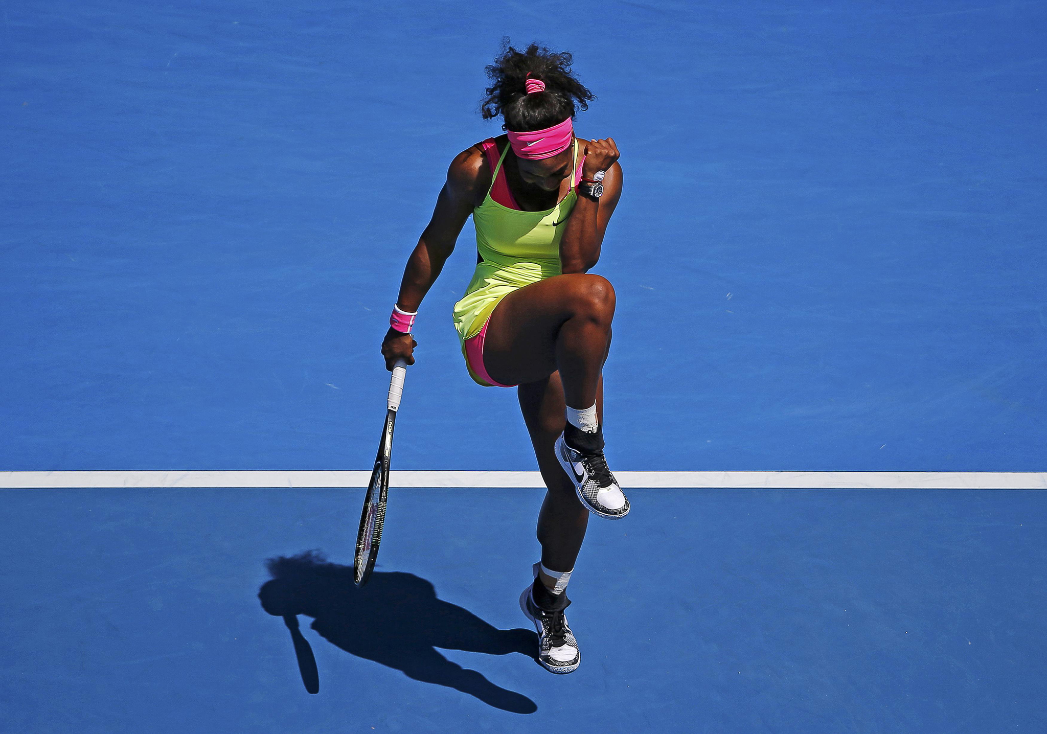 Serena of the U.S. celebrates defeating Cibulkova of Slovakia to win their women's singles quarter-final match at the Australian Open 2015 tennis tournament in Melbourne...Serena Williams of the U.S. celebrates defeating Dominika Cibulkova of Slovakia to win their women's singles quarter-final match at the Australian Open 2015 tennis tournament in Melbourne January 28, 2015.     REUTERS/Carlos Barria (AUSTRALIA  - Tags: SPORT TENNIS)