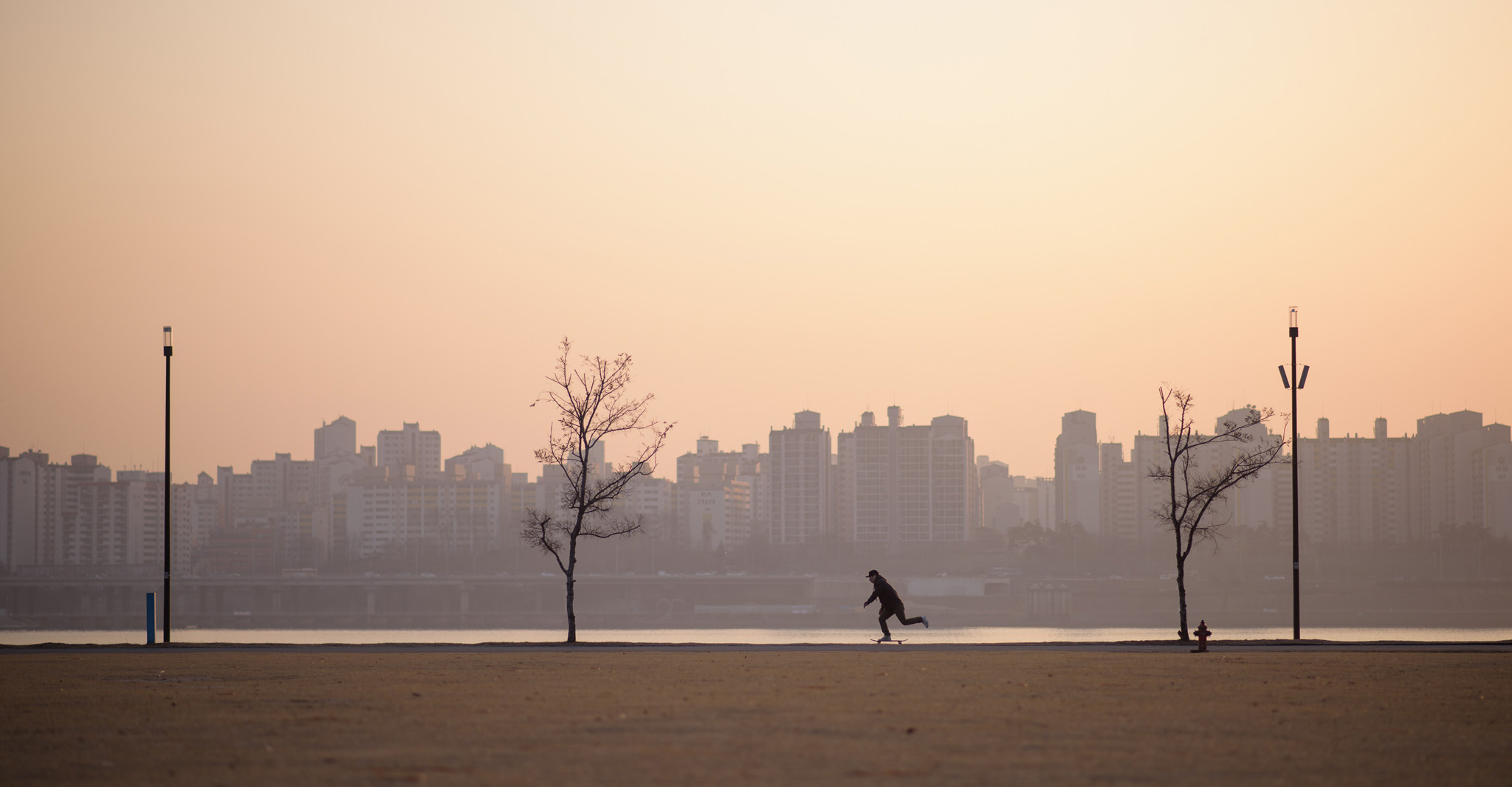 n a photo taken on January 15,...TOPSHOTS In a photo taken on January 15, 2015 a skateboarder passes alongside the Han river at dusk in Seoul. South Korea's central bank slashed its 2015 economic growth forecast and kept its benchmark interest rate unchanged at a record low amid growing concerns of deflation. AFP PHOTO / Ed JonesED JONES/AFP/Getty Images