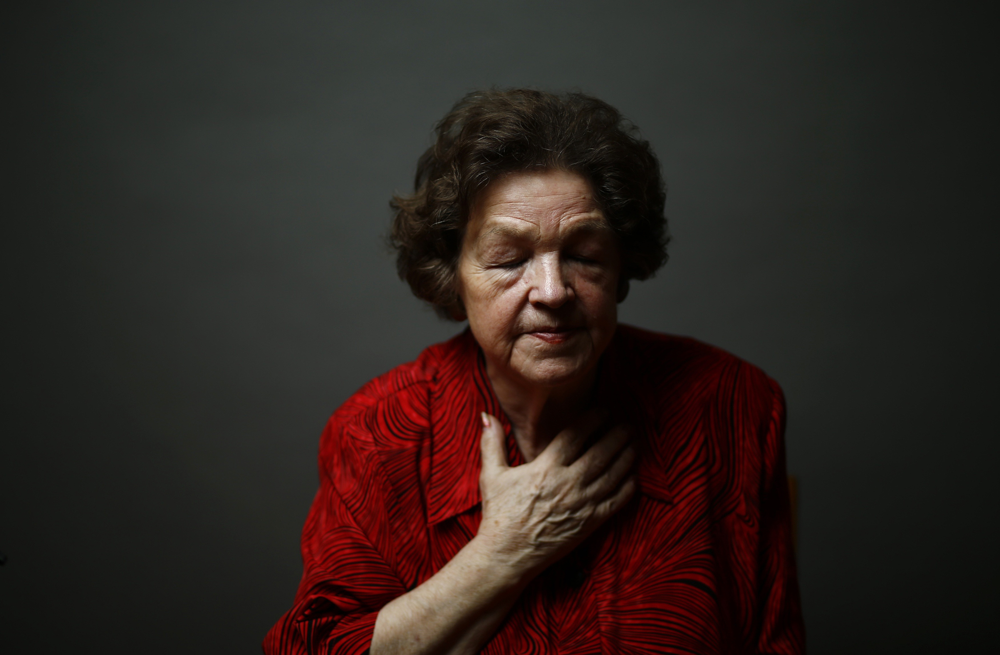 Auschwitz death camp survivor Danuta Bogdaniuk-Bogucka poses for a portrait in Warsaw...Auschwitz death camp survivor Danuta Bogdaniuk-Bogucka (maiden name Kaminska), 80, poses for a portrait in Warsaw January 5, 2015. Bogdaniuk-Bogucka was 10-years-old when she was sent to Auschwitz-Birkenau camp with her mother. Bogdaniuk-Bogucka was part of Josef Mengele's experiments when she was in Auschwitz. After the war she met her mother again and they discovered they had both been at Ravensbruck camp at the same time, but they had not realised this. As the liberation of Auschwitz approaches its 70th anniversary this month, Reuters photographers took portraits of now elderly survivors. About 1.5 million people, most of them Jews, were killed at the Nazi camp which has became a symbol of the horrors of the Holocaust and World War Two, which ravaged Europe. The camp was liberated by Soviet Red Army troops on January 27, 1945 and about 200,000 camp inmates survived. REUTERS/Kacper Pempel (POLAND - Tags: ANNIVERSARY SOCIETY PORTRAIT CONFLICT)    ATTENTION EDITORS: PICTURE 18 OF 30 FOR WIDER IMAGE PACKAGE 'AUSCHWITZ SURVIVORS, 70 YEARS ON'    TO FIND ALL IMAGES SEARCH 'WWII SURVIVORS REUTERS'