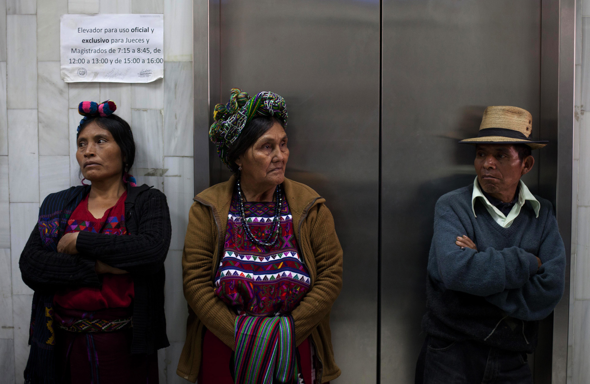 Ixil Indians wait outside the courtroom in Guatemala City where Guatemala's former dictator Efrain Rios Montt is facing charges of genocide and crimes against. Rios Montt was convicted for the massacre of thousands during his 1982-83 regime in what was considered a historic 2013 ruling. But his 80-year sentence was later overturned and a restart to the trial ordered.