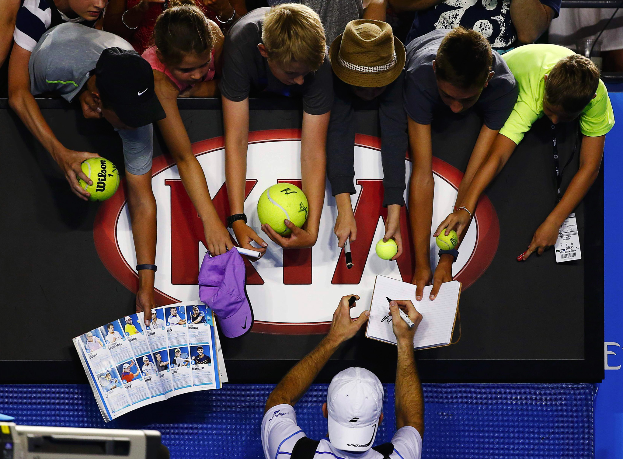 Benjamin Becker of Germany signs autographs after defeating Lleyton Hewitt of Australia in their men's singles second round match at the Australian Open.