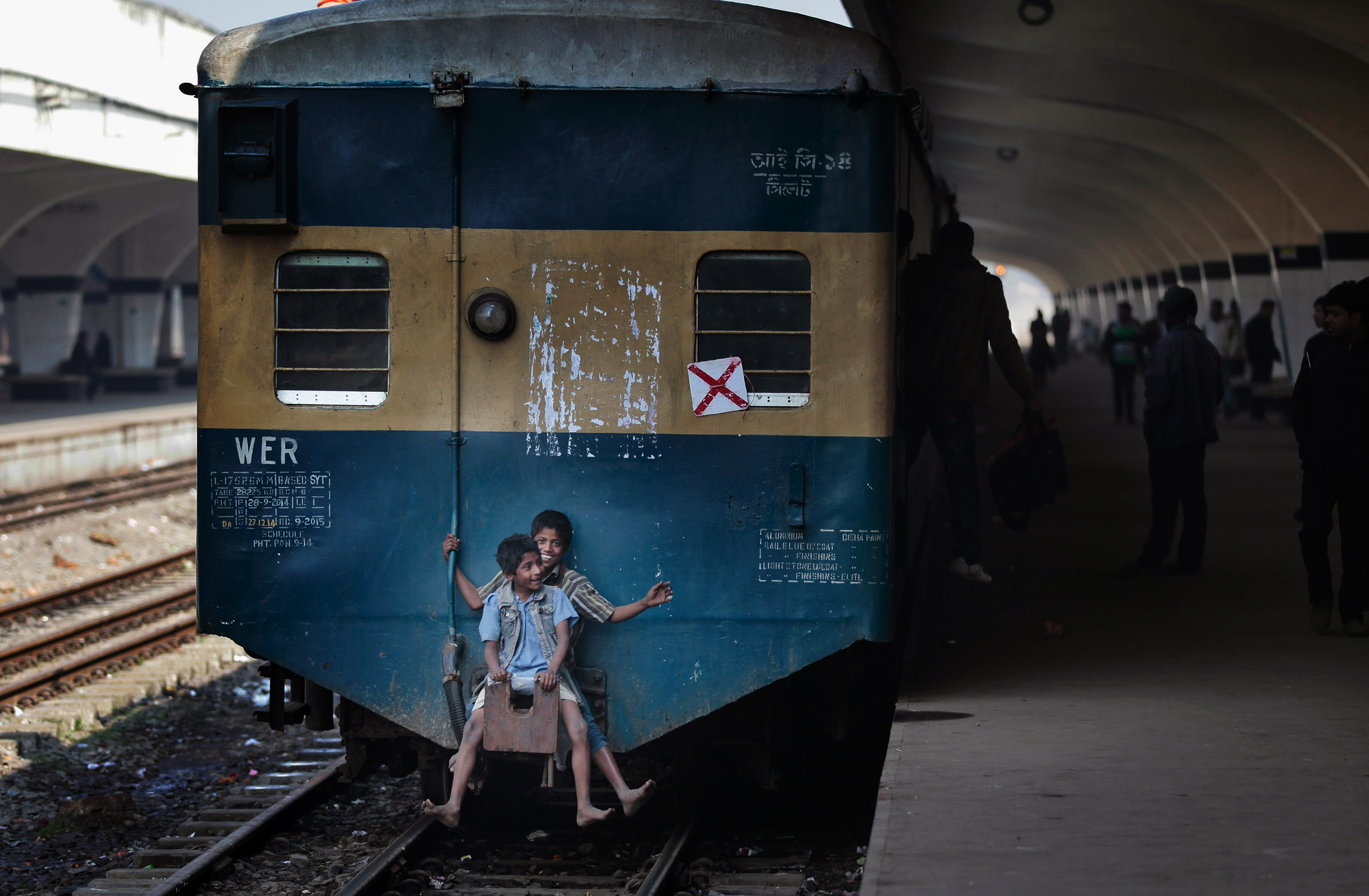 Bangladeshi children travel at the back of a moving train at a railway station during the second day of a 48-hour general strike called by the opposition Bangladesh Nationalist Party (BNP) in Dhaka, Bangladesh.