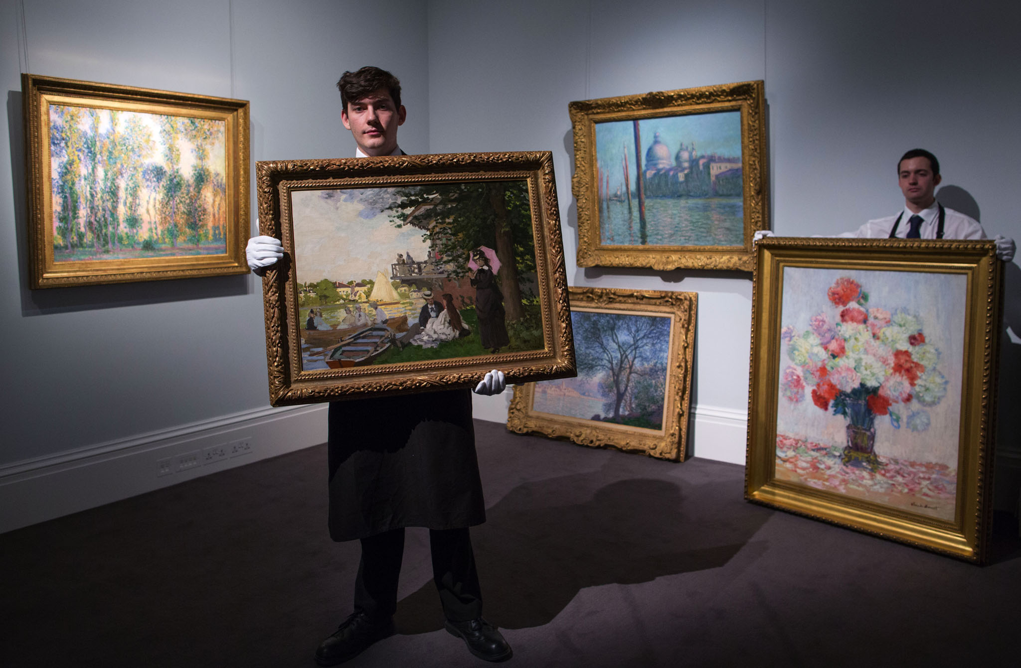 Gallery technicians at Sotheby's Bond Street get ready to exhibit five Monet's with a value in excess of  70 million which are coming up for auction.