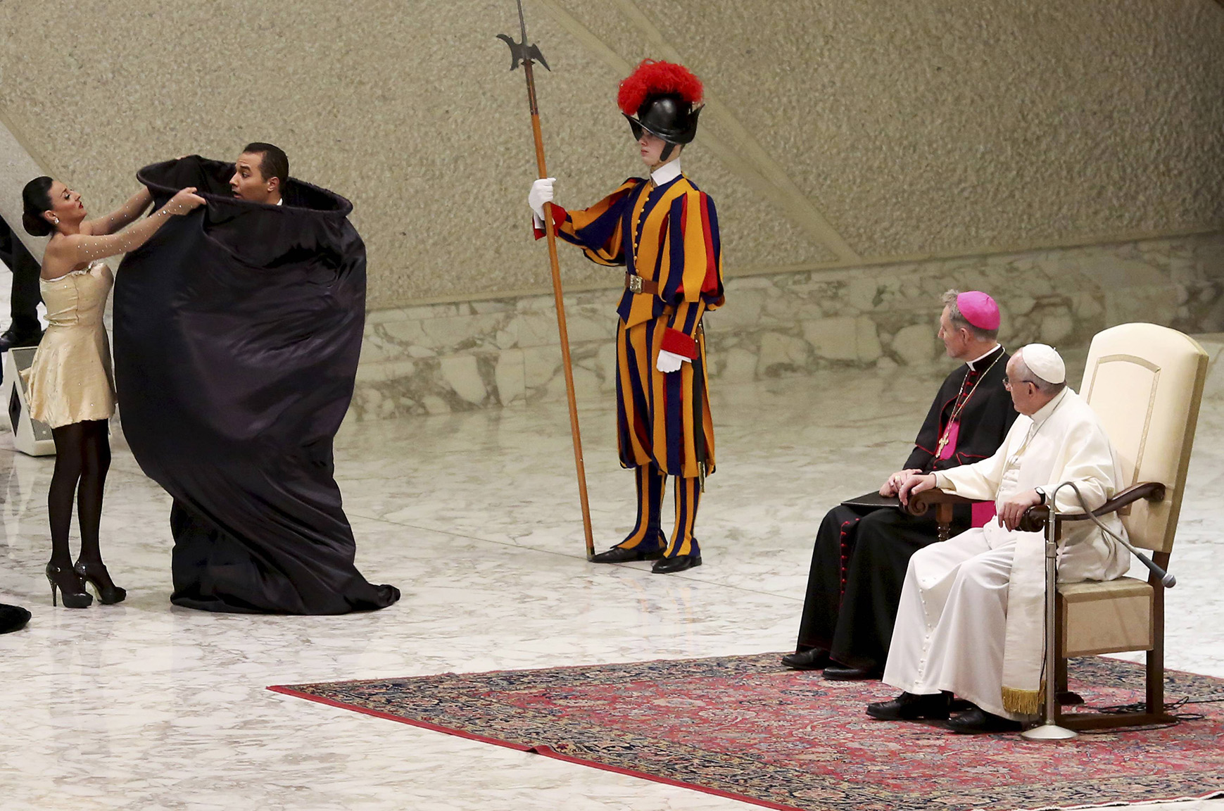 Circus artists perform in front of Pope Francis during the Wednesday general audience in Paul VI hall at the Vatican