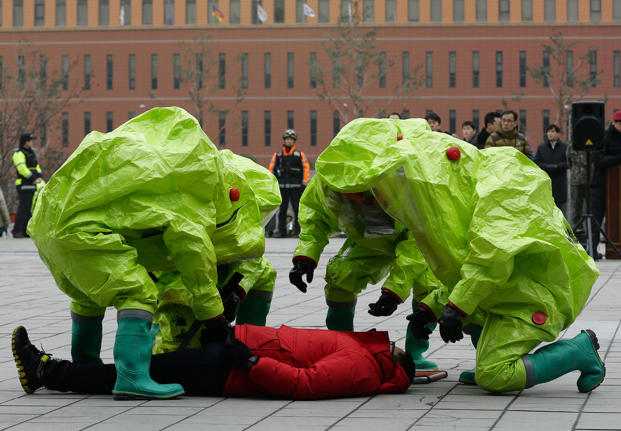 South Korean firefighters wearing protective gear take care of  a mock victim during an exercise against a possible terrorist attack in Seoul, South Korea.