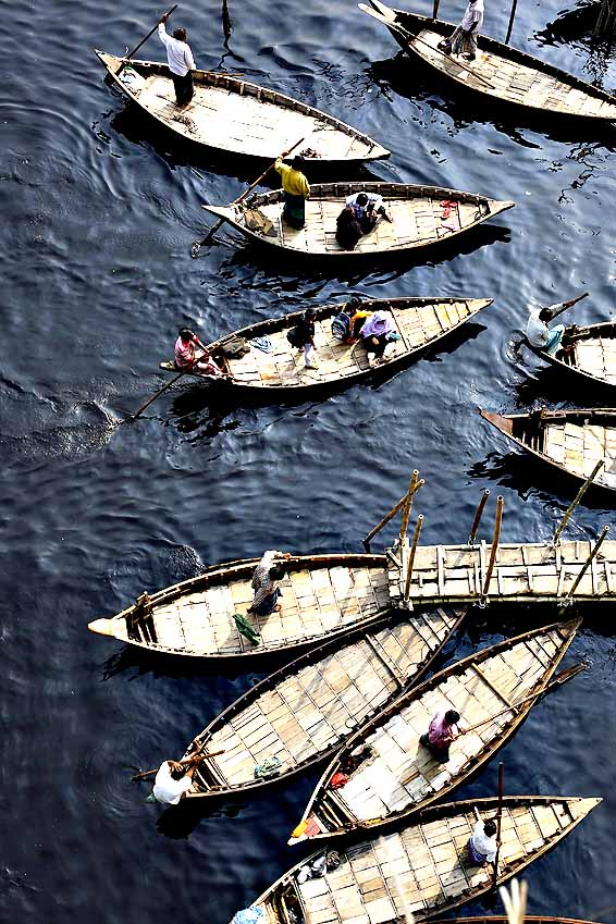 Country wide strike called by the Bangladesh Nationalist Party...epa04592536 People travel on boats as they cross the Buriganga river during the country wide strike called by the Bangladesh Nationalist Party (BNP) at Keranigonj in Dhaka, Bangladesh, 29 January 2015. Violence erupted in different parts of the country after former prime minister Khaleda Zia called a nationwide transport blockade on 05 January, the first anniversary of a controversial election that her Bangladesh Nationalist Party (BNP) and allies boycotted. According to official estimates, at least 35 people have since been killed in firebomb attacks on passenger buses, cars and trucks as vehicles plied on highways in defiance of the blockade.