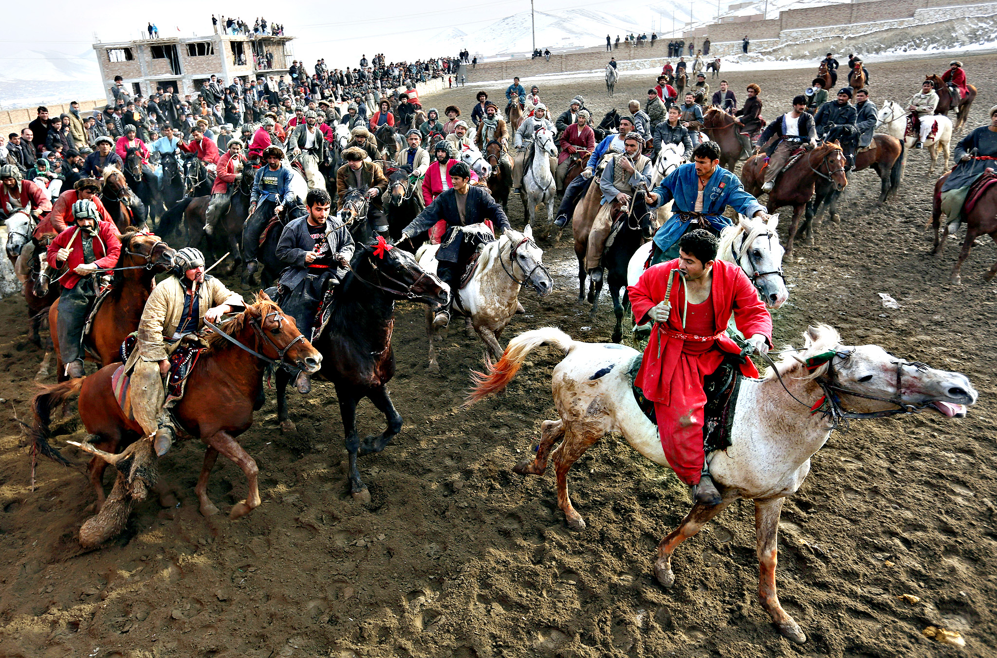 Afghan horse riders compete for the goat during a friendly buzkashi match on the outskirts of Kabul, Afghanistan, Thursday, Jan. 29, 2015. Buzkashi is a traditional and the national sport of Afghanistan, where players compete to place a goat carcass into a goal circle. It was banned during the Taliban rule.