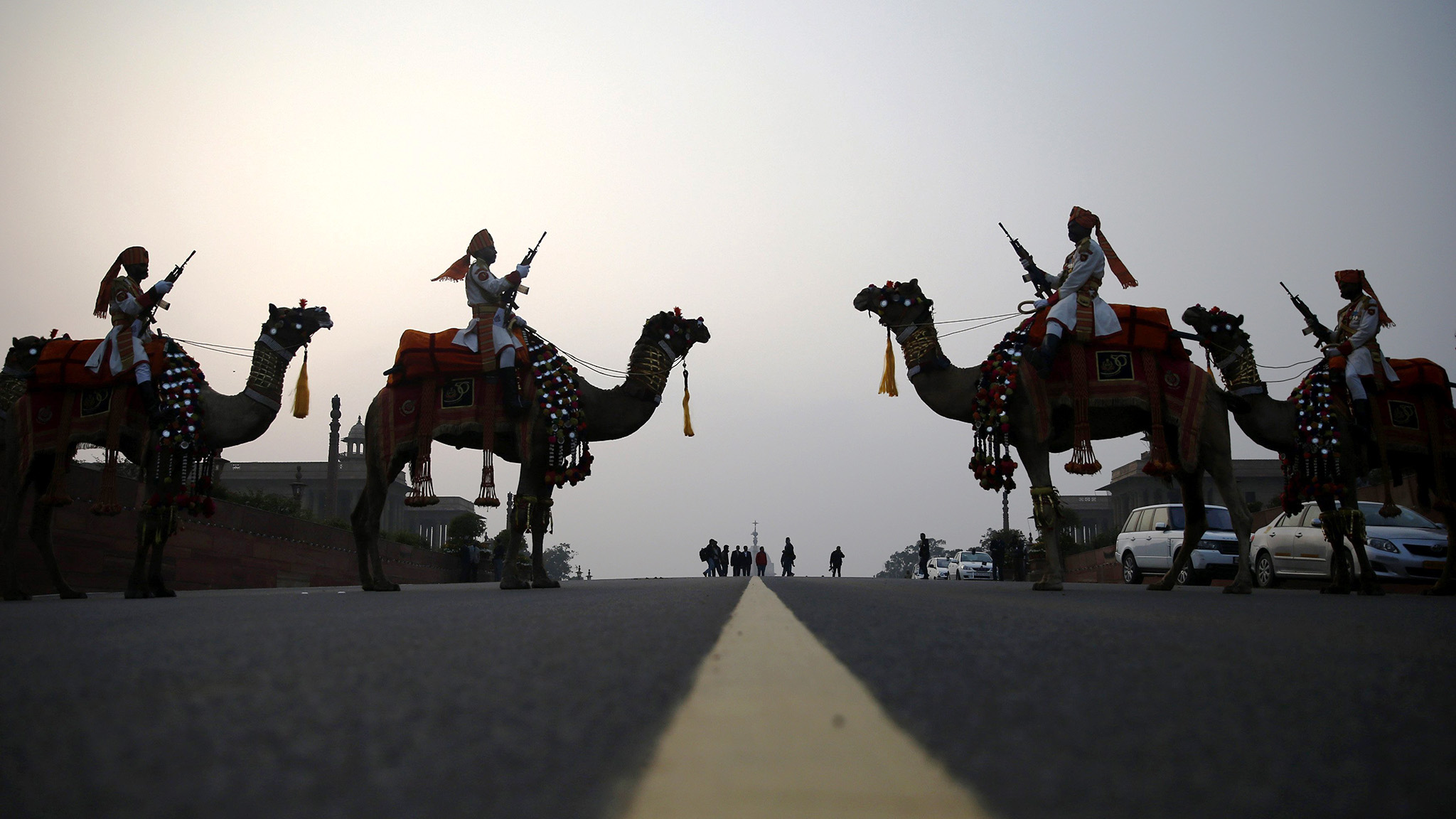 "India's BSF soldiers ride camels as they rehearse for ""Beating Retreat"" ceremony in New Delhi"