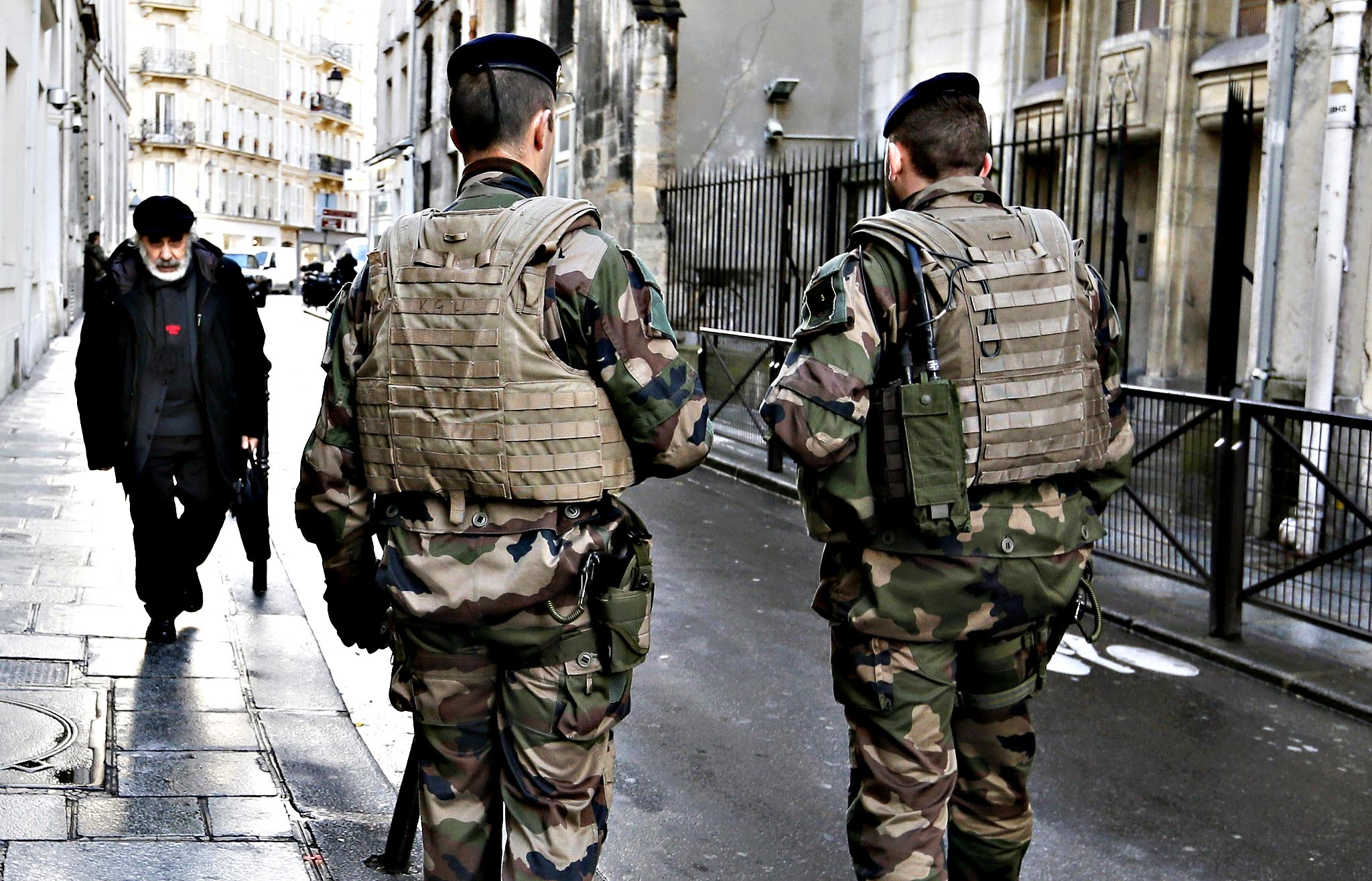 "French soldiers patrol the street in a Jewish neighbourhood near a religious school and a synagogue as part of the highest level of ""Vigipirate"" security plan after last week's Islamic attacks in Paris...French soldiers patrol the street in a Jewish neighbourhood near a religious school and a synagogue as part of the highest level of ""Vigipirate"" security plan after last week's Islamic attacks in Paris January 14, 2015. France deploys 10,000 soldiers on home soil and posts almost 5,000 extra police officers after the killing of 17 people by Islamist militants in Paris last week, officials said."