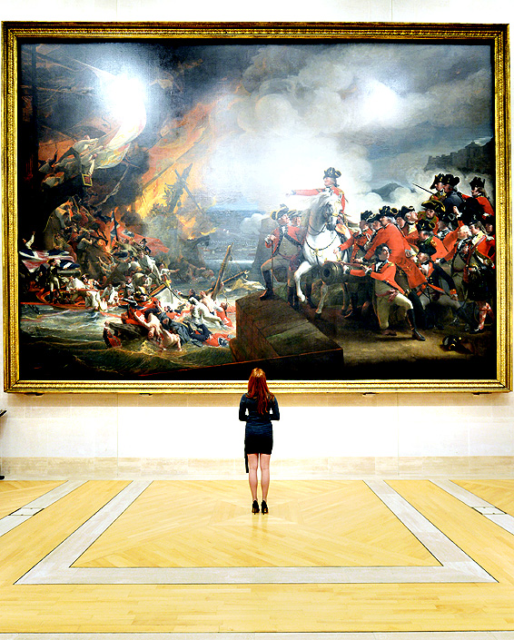 Art historian Chloe Nelkin views Defeat of the Floating Batteries at Gibraltar, 1782, by John Singleton Copley during the Guildhall Art Gallery's re-launch following a re-hang for the first time in 15 years, Guildhall Art Gallery, London.