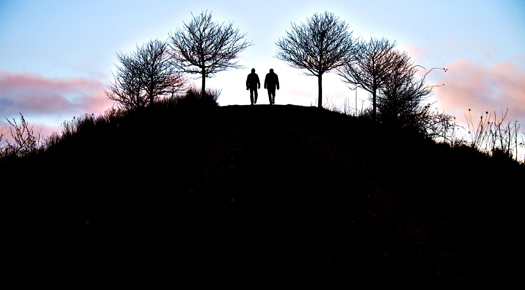 Two men stroll at the Kronsberg hill near Hannover, northern Germany, Friday morning, Jan. 23, 2015.